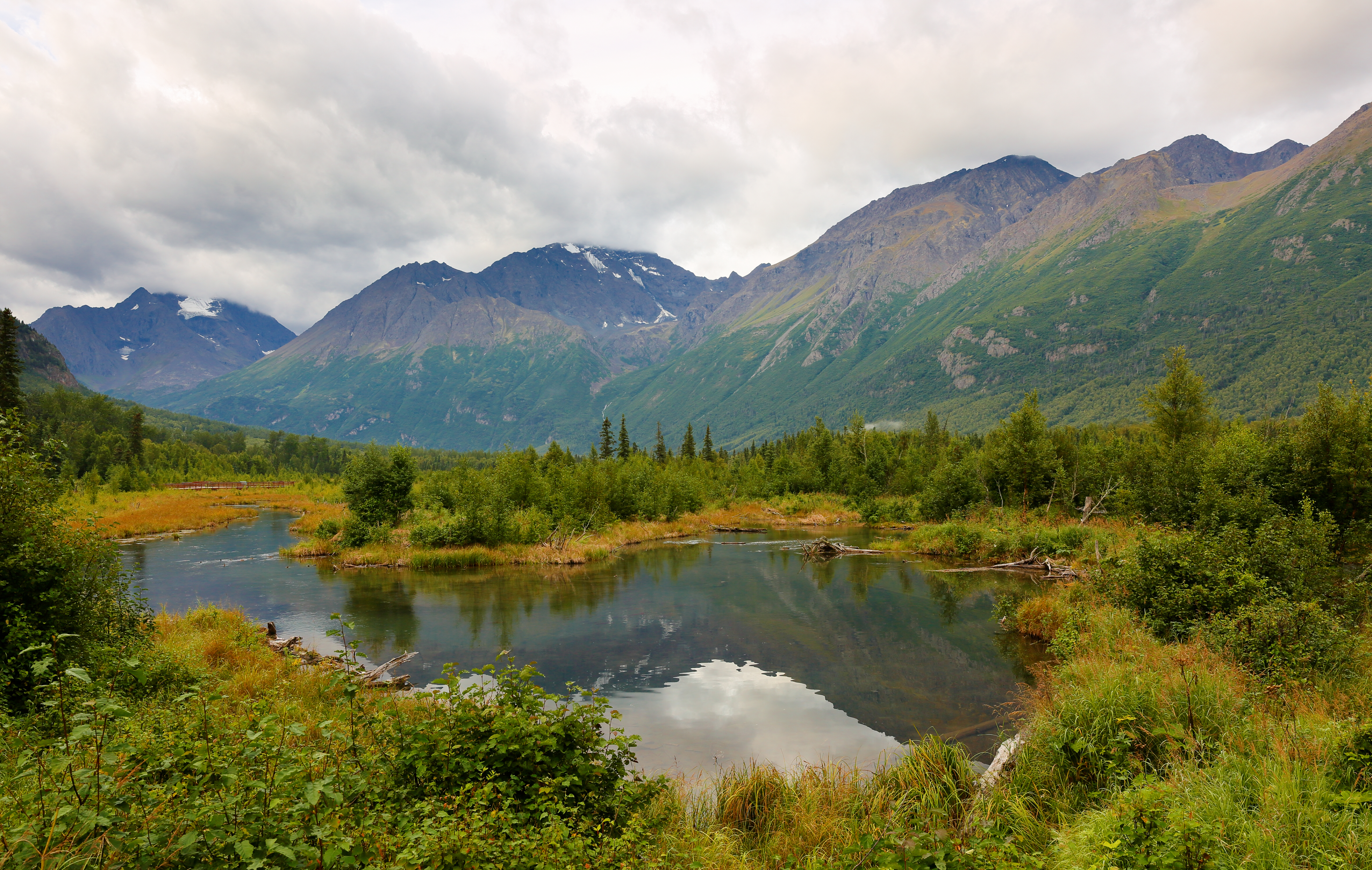 Eagle River nature center at early morning, Eagle River, Alaska. Forty minutes from downtown Anchorage, Eagle River Nature Center is a gateway to Chugach State Park and a glacial river valley. Shutterstock image via user Jay Yuan