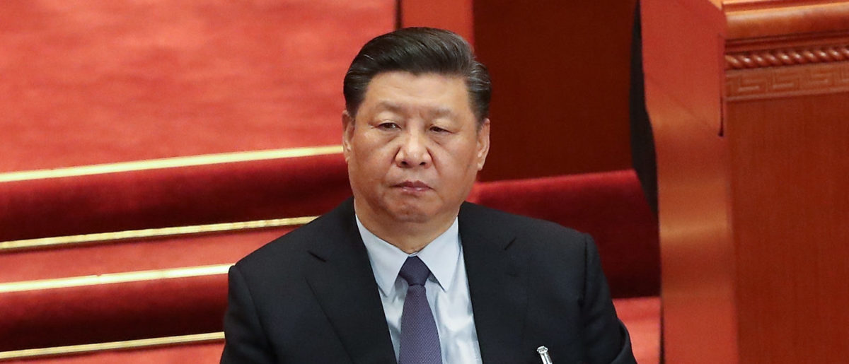 Chinese President Xi Jinping listens at Chairman of the Standing Committee of the National People's Congress (NPC) Li Zhanshu's speech, during the second plenary meeting of the NPC at The Great Hall Of The People on March 8, 2019 in Beijing, China. (Photo by Andrea Verdelli/Getty Images)