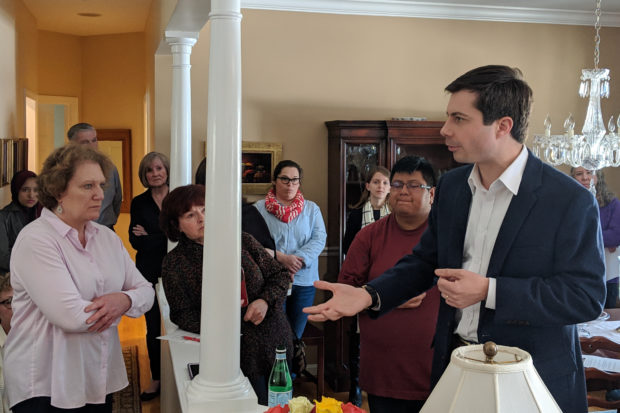 Mayor Pete Buttigieg talks with supporters at a local event Marc Nozell Creative Commons