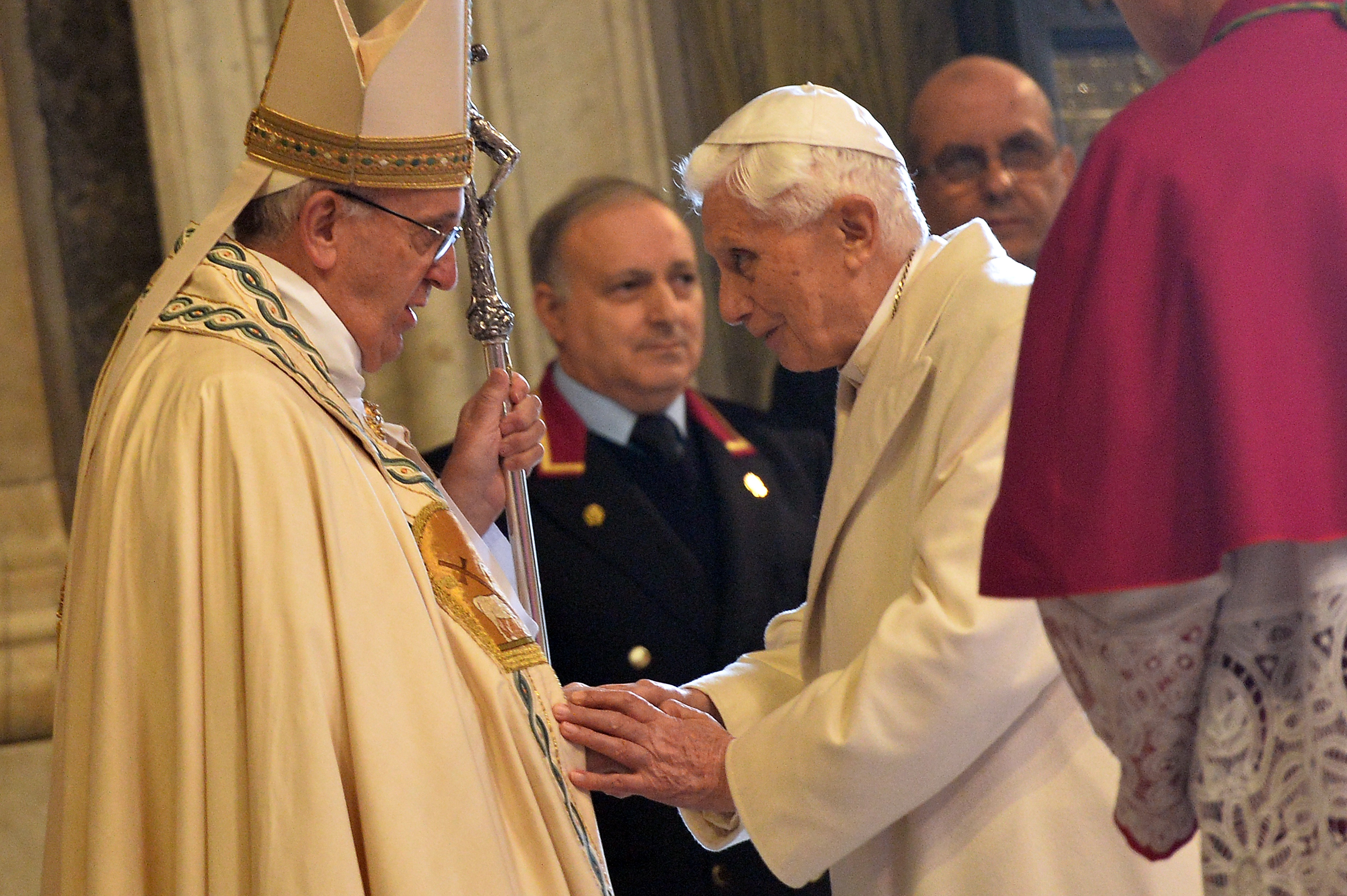 Pope Emeritus Benedict XVI (R) speaks to Pope Francis during the ceremony marking the start of the Jubilee Year of Mercy, on December 8, 2015 in Vatican. (ALBERTO PIZZOLI/AFP/Getty Images)