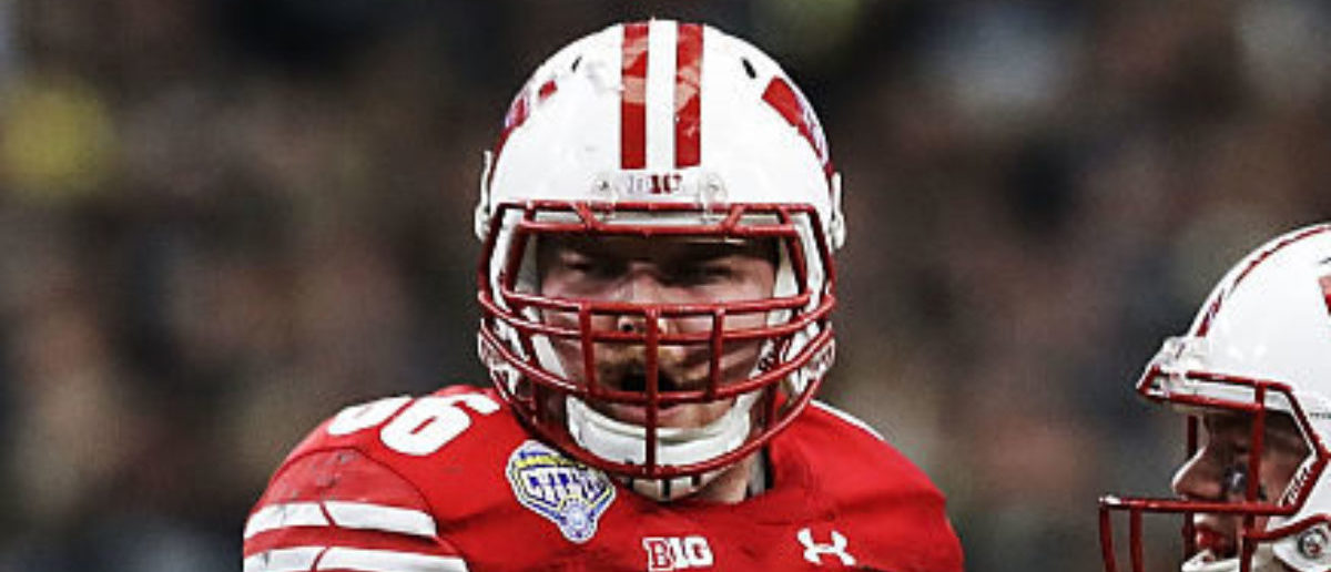 ARLINGTON, TX - JANUARY 02: Alex Hornibrook #12 and Beau Benzschawel #66 of the Wisconsin Badgers celebrate after a touchdown in the fourth quarter during the 81st Goodyear Cotton Bowl Classic between Western Michigan and Wisconsin at AT&T Stadium on January 2, 2017 in Arlington, Texas. (Photo by Ronald Martinez/Getty Images)