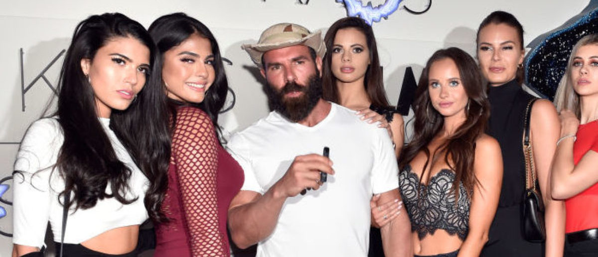 LAS VEGAS, NEVADA - APRIL 06: Dan Bilzerian (3rd L) and guests attend the grand opening of KAOS Dayclub & Nightclub at Palms Casino Resort on April 06, 2019 in Las Vegas, Nevada. (Photo by David Becker/Getty Images for Palms Casino Resort)