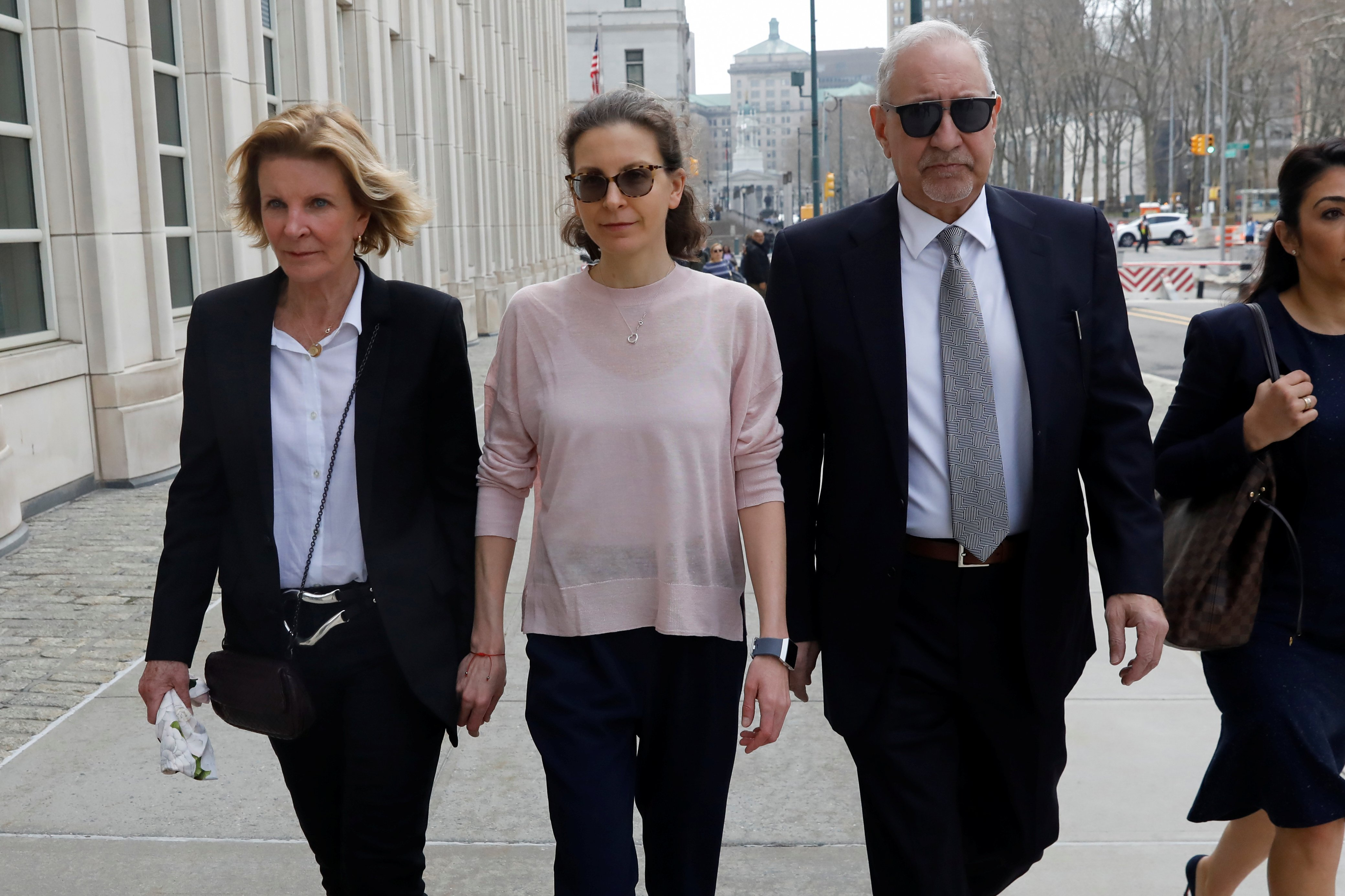Clare Bronfman, an heiress of the Seagram's liquor empire, arrives at the Brooklyn Federal Courthouse to face charges regarding sex trafficking and racketeering related to the Nxivm cult case in New York, U.S., April 8, 2019. REUTERS/Shannon Stapleton - RC17567F4AF0