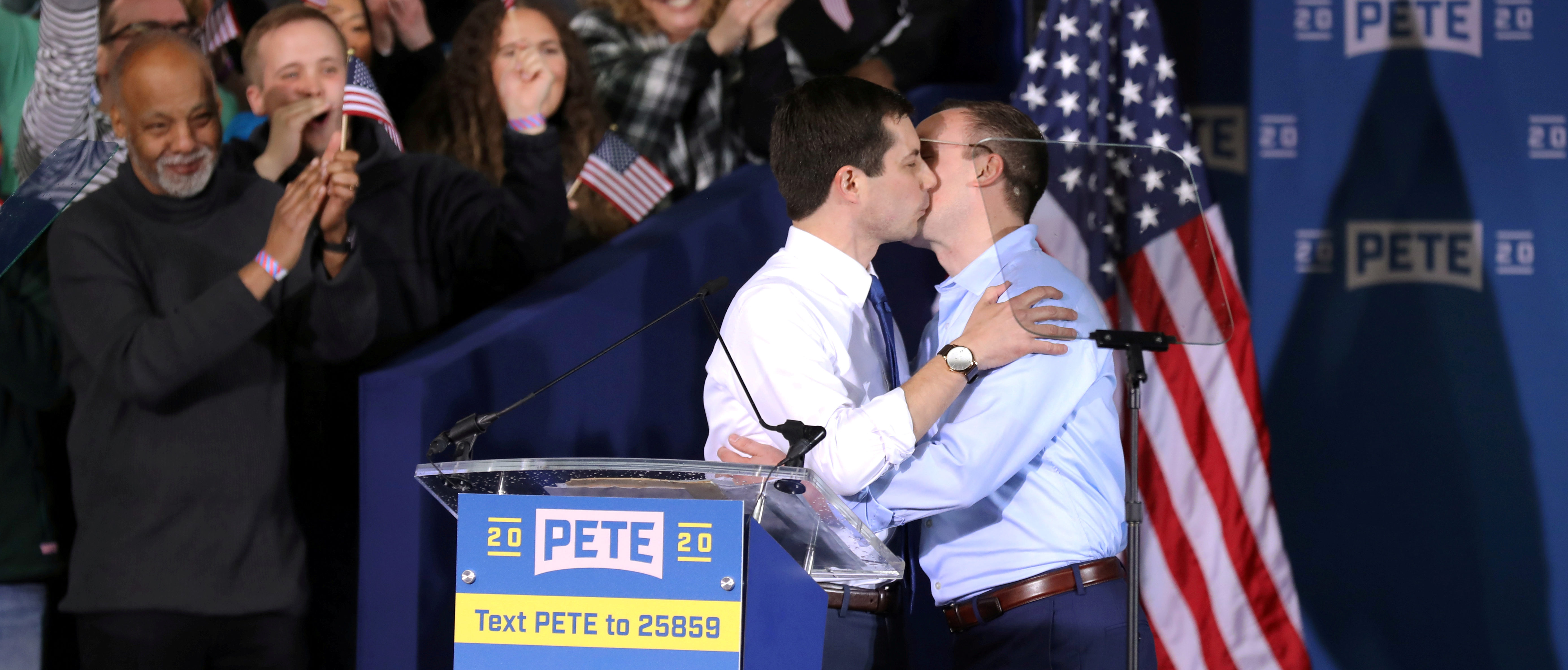 South Bend's Mayor Pete Buttigieg and his husband Chasten Buttigieg kiss as they attend a rally to announce Pete Buttigieg's 2020 Democratic presidential candidacy in South Bend, Indiana, U.S., April 14, 2019. REUTERS/John Gress