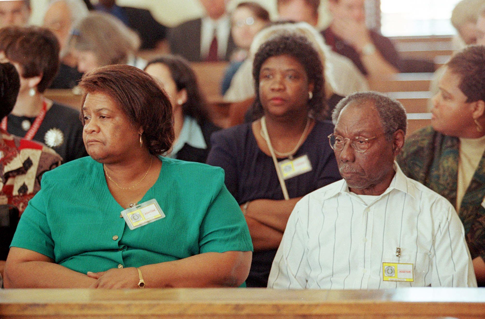 James Byrd Sr. (R) sits in the front row of the Jasper County Courthouse for day one of the capital murder trial of Bill King in Jasper, Texas February 16, 1999. At left is the sister of murder victim James Byrd Jr., Stella Brumley. (Adrees Latif/AFP/Getty Images)