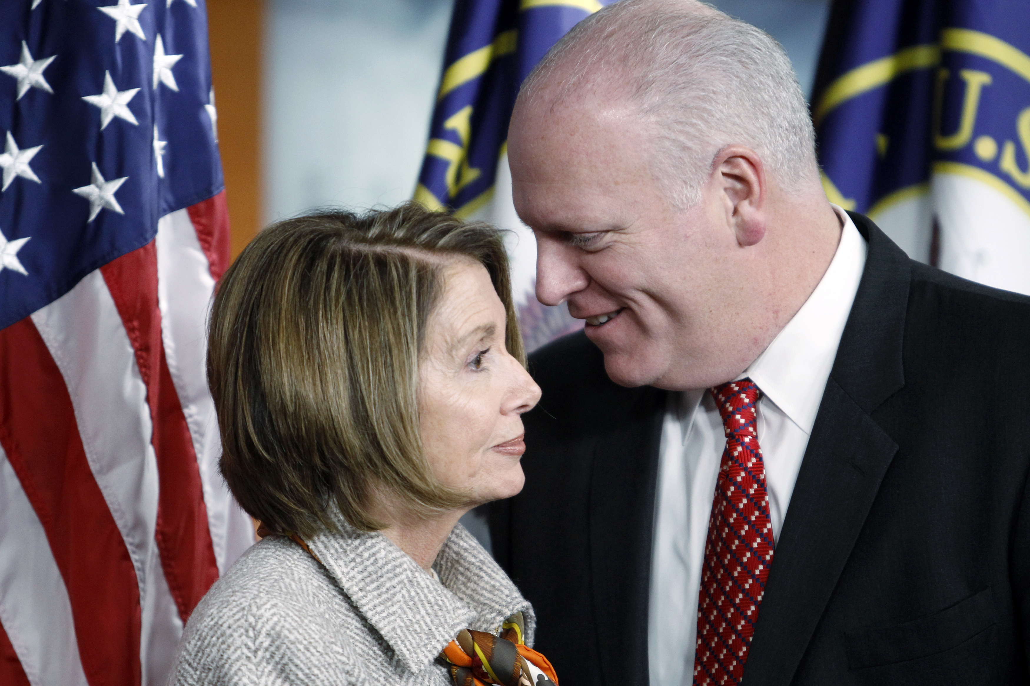 "U.S. House Speaker Nancy Pelosi (D-CA) (L) shares a conversation with Representative Joe Crowley (D-NY) after the passage of the ""Dream Act"" in the House of Representatives in Washington, December 17, 2010. The Dream Act legislation allows young individuals who were brought into the U.S. illegally by their parents to gain a legal status by completing two years of college or military service. REUTERS/Hyungwon Kang"