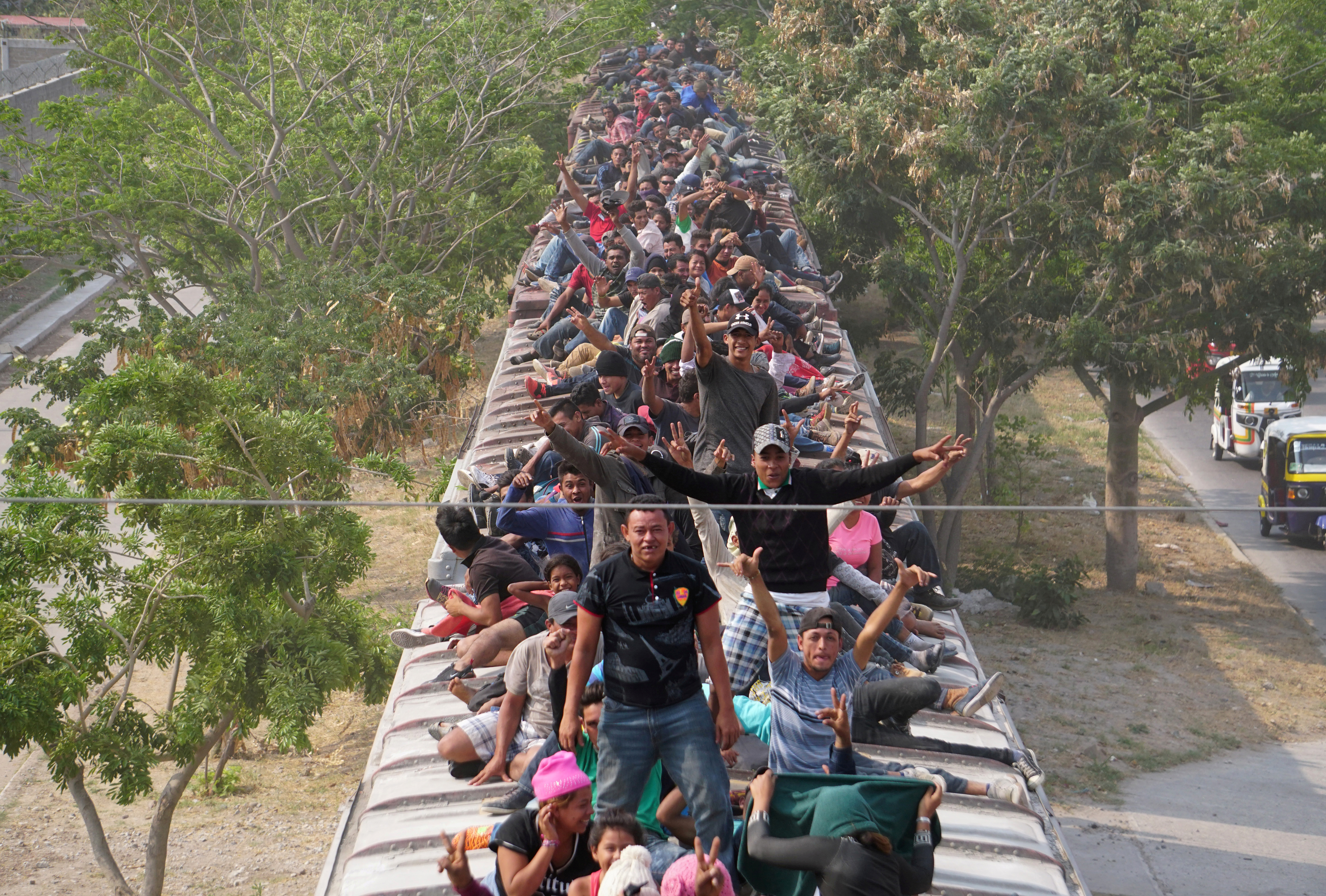 Central American migrants ride train through Juchitan, Oaxaca