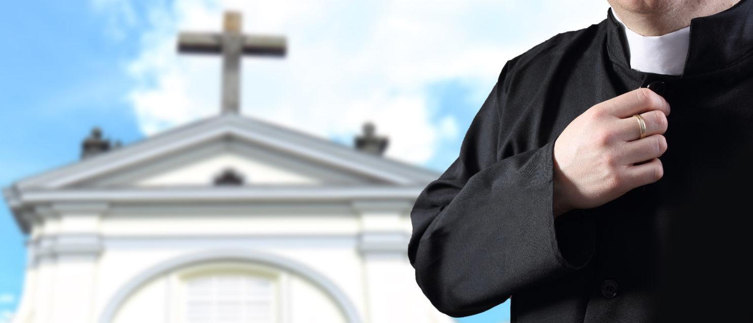 A Catholic Priest (Shutterstock/ ambrozinio)