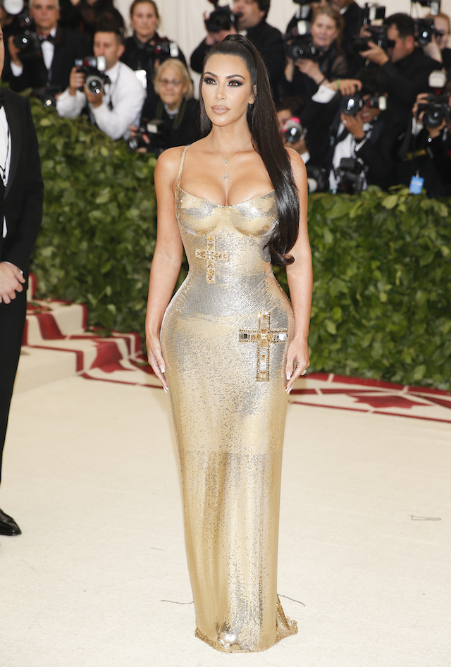 Kim Kardashian arrives at the Metropolitan Museum of Art Costume Institute Gala (Met Gala) to celebrate the opening of ìHeavenly Bodies: Fashion and the Catholic Imaginationî in the Manhattan borough of New York, U.S., May 7, 2018. REUTERS/Carlo Allegri