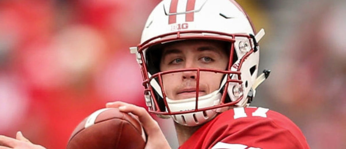 MADISON, WISCONSIN - NOVEMBER 03: Jack Coan #17 of the Wisconsin Badgers throws a pass in the fourth quarter against the Rutgers Scarlet Knights at Camp Randall Stadium on November 03, 2018 in Madison, Wisconsin. (Photo by Dylan Buell/Getty Images)