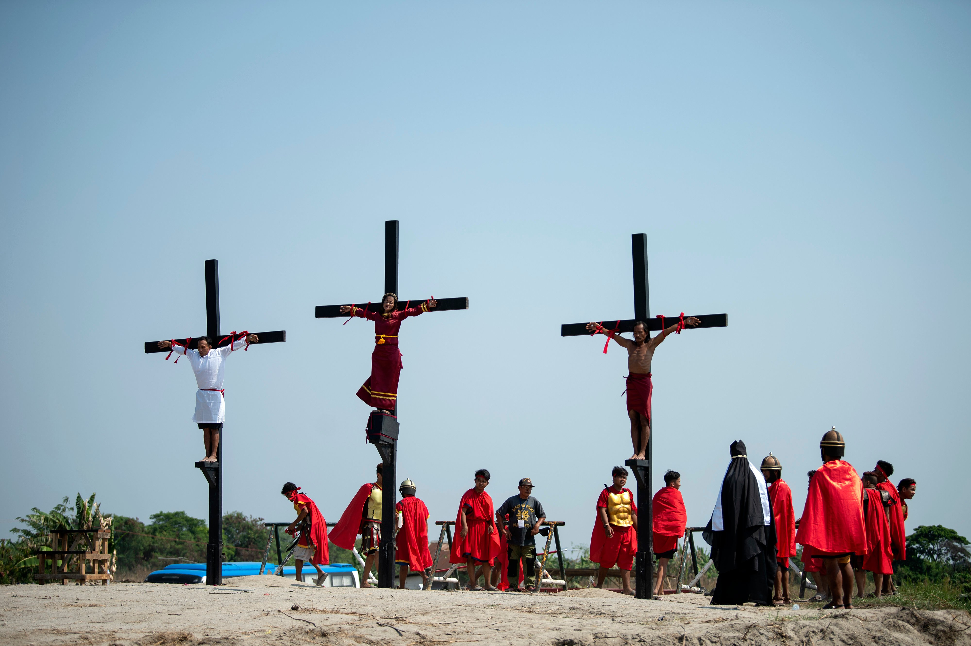 Philippine Christian devotees are nailed to crosses during a reenactment of the Crucifixion of Christ during Good Friday ahead of Easter in the village of Cutud near San Fernando on April 19, 2019. (NOEL CELIS/AFP/Getty Images)