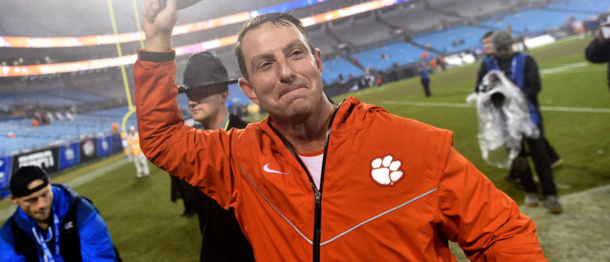 CHARLOTTE, NC - DECEMBER 01: Head coach Dabo Swinney of the Clemson Tigers salutes the fans as he leaves the field after their win against the Pittsburgh Panthers in the ACC Championship game at Bank of America Stadium on December 1, 2018 in Charlotte, North Carolina. Clemson won 42-10. (Photo by Grant Halverson/Getty Images)