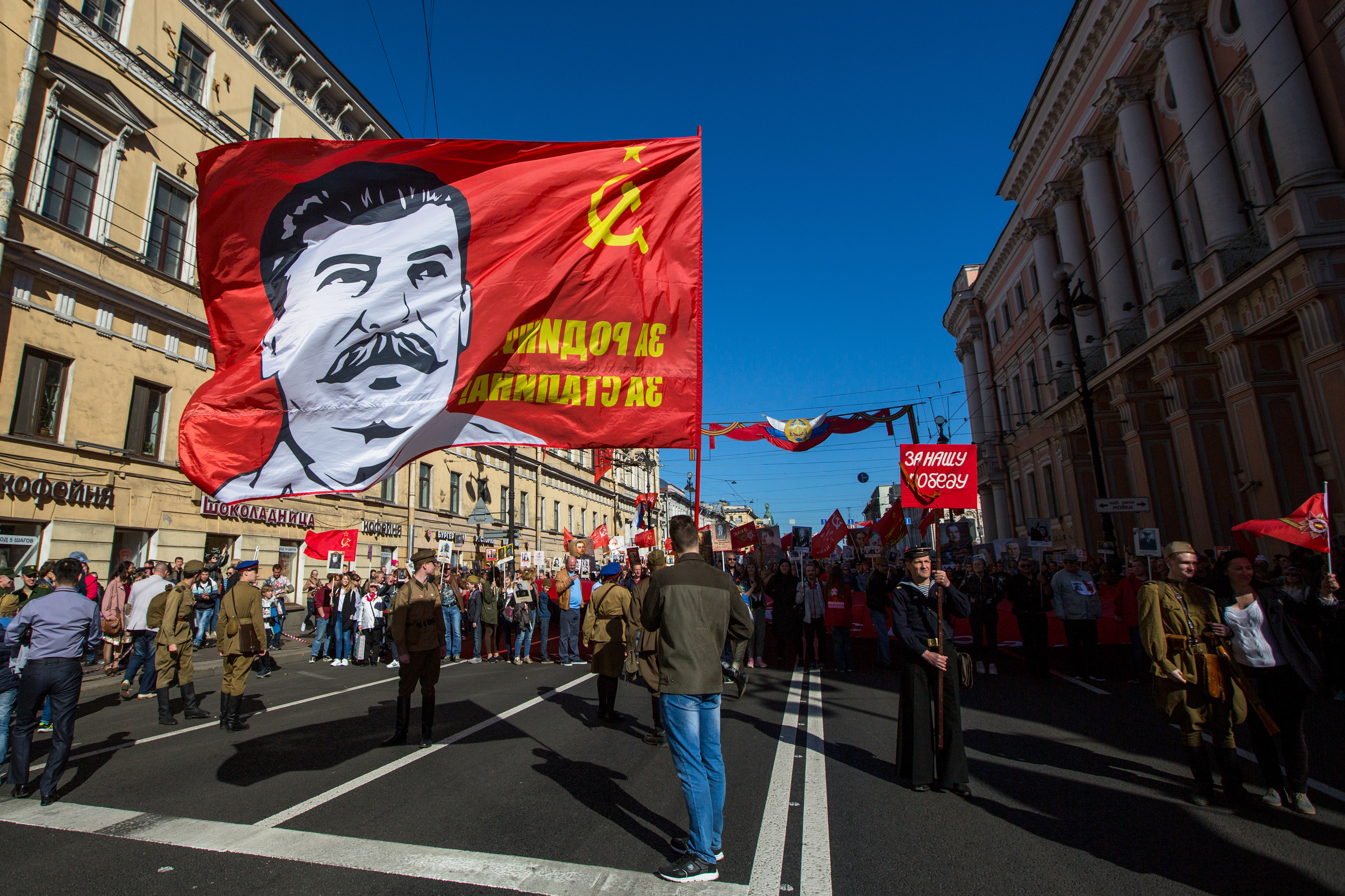ST. PETERSBURG, RUSSIA - MAY 9, 2018- Communist party is involved during action Immortal Regiment march during the Victory Day celebrations. On the banner photo of Joseph Stalin. De Visu Shutterstock.