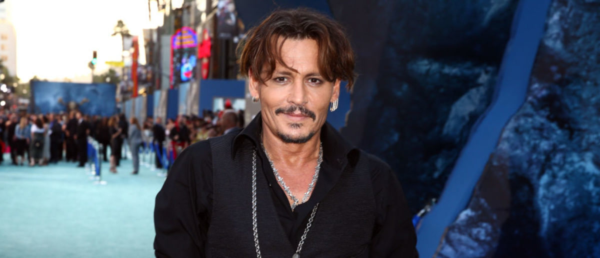 """HOLLYWOOD, CA - MAY 18: Actor Johnny Depp attends the premiere of Disney's """"Pirates Of The Caribbean: Dead Men Tell No Tales"""" at Dolby Theatre on May 18, 2017 in Hollywood, California. (Photo by Rich Fury/Getty Images)"""