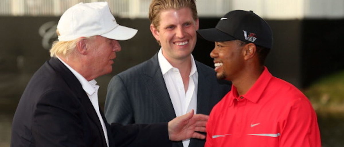 DORAL, FL - MARCH 10: Developer Donald Trump (L) greets Tiger Woods after the final round of the World Golf Championships-Cadillac Championship as Eric Trump looks on at the Trump Doral Golf Resort & Spa on March 10, 2013 in Doral, Florida. (Photo by Warren Little/Getty Images)