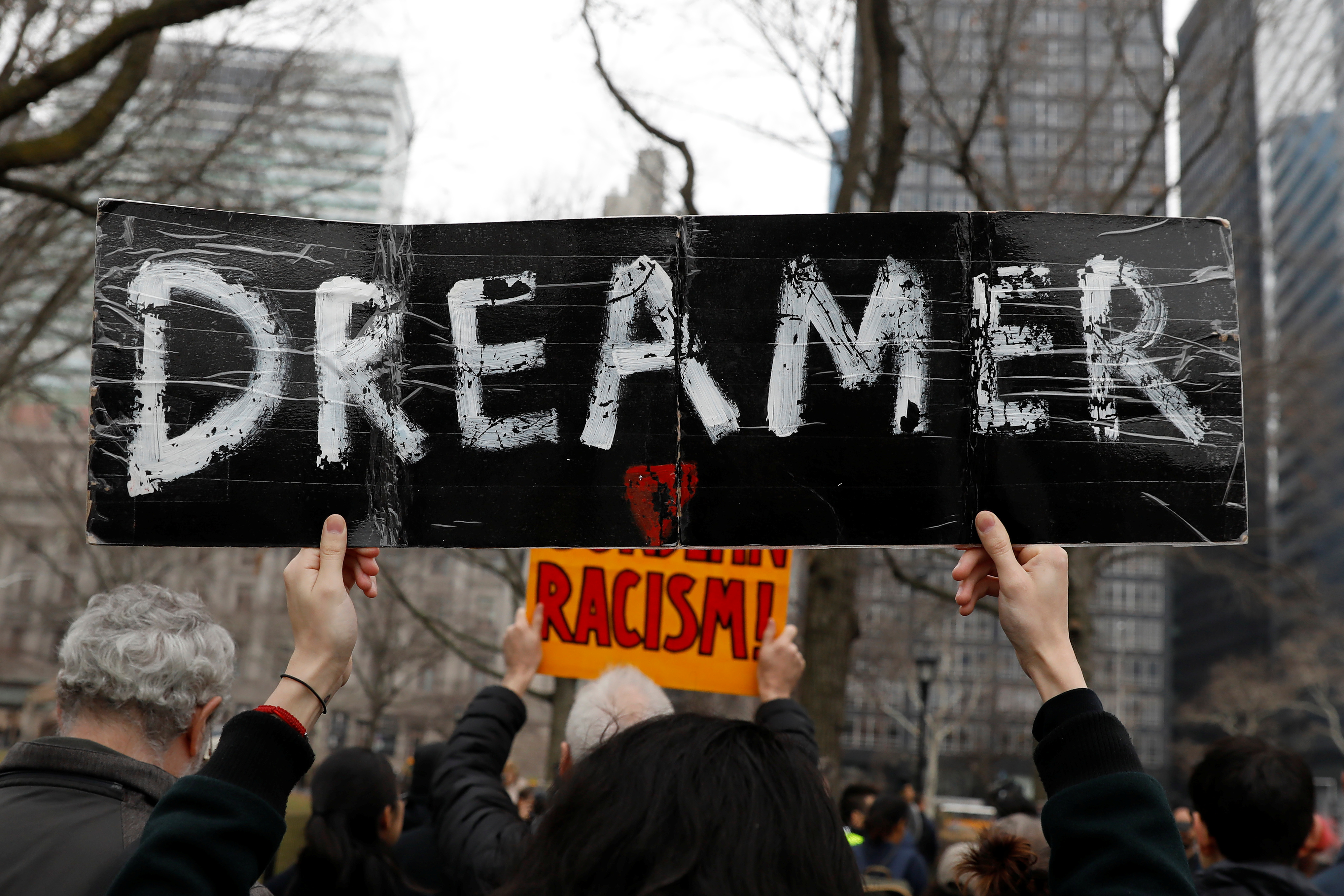 Activists and DACA recipients march up Broadway during the start of their 'Walk to Stay Home,' a five-day 250-mile walk from New York to Washington D.C., to demand that Congress pass a Clean Dream Act, in Manhattan, New York, U.S., February 15, 2018. REUTERS/Shannon Stapleton