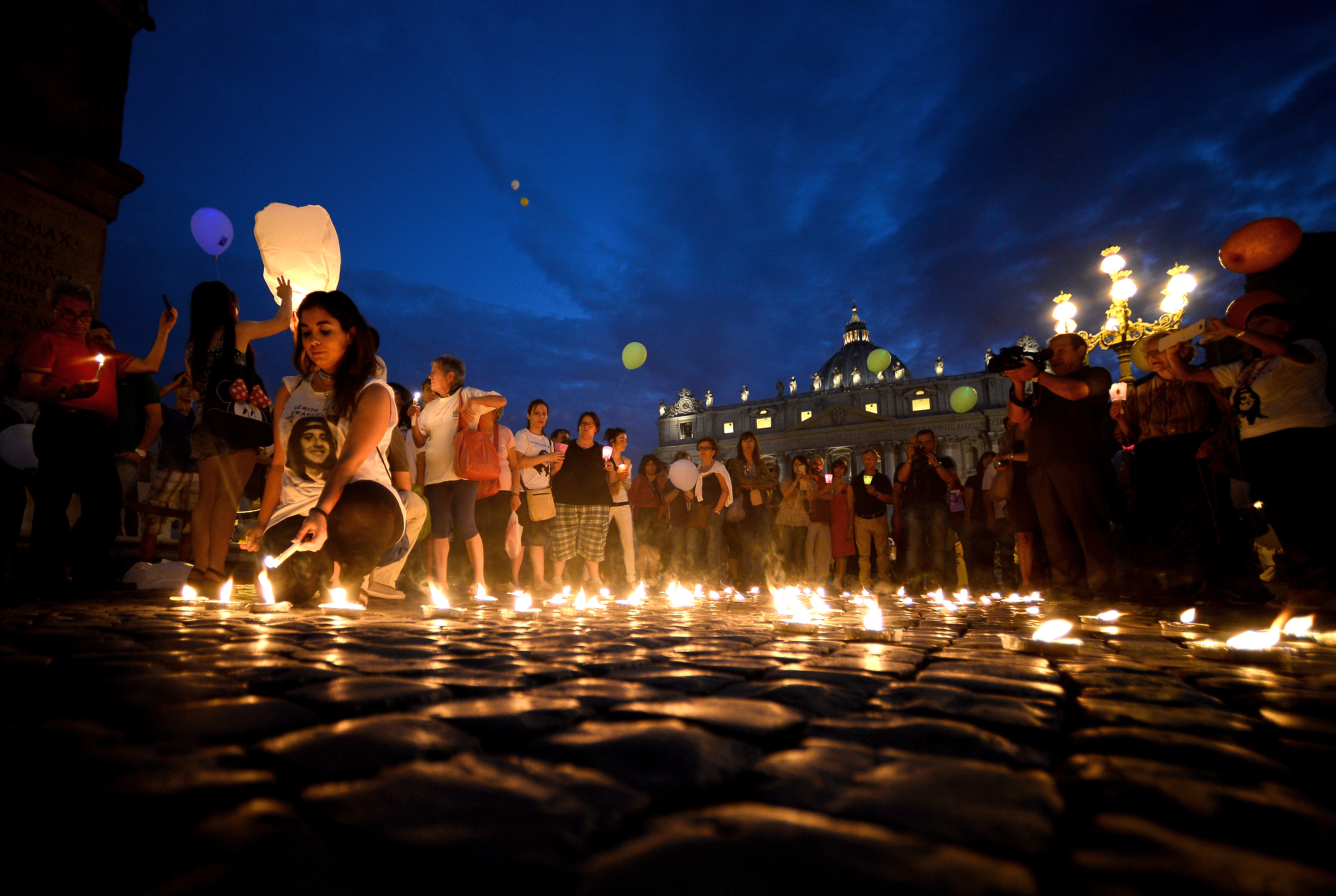 Demonstrators light candels as they commemorate the 30th anniversary of Emanuela Orlandi disappearance in Saint Peter's Square at the Vatican on June 22, 2013. (FILIPPO MONTEFORTE/AFP/Getty Images)