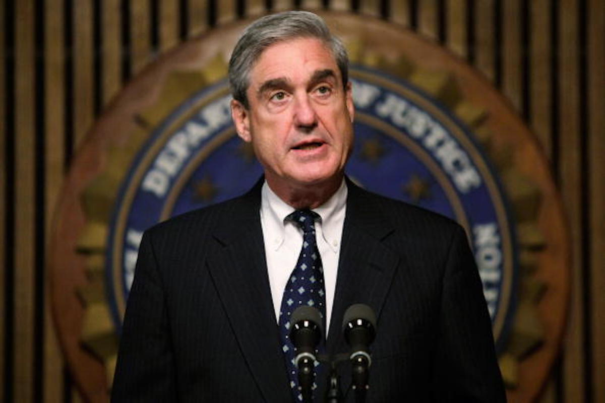 FBI Director Robert Mueller speaks during a news conference at the FBI headquarters