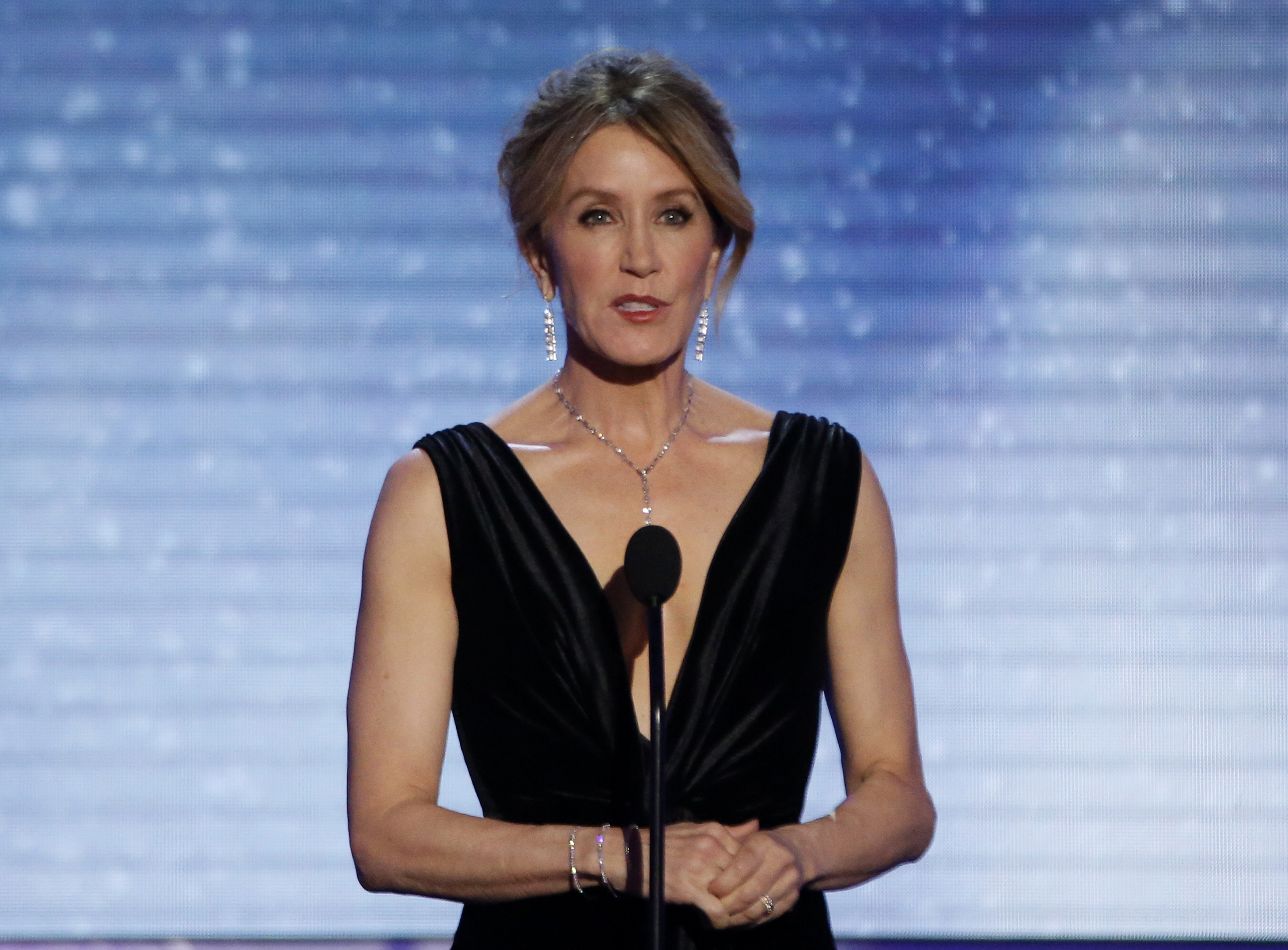 Felicity Huffman speaks on stage. REUTERS/Mario Anzuoni