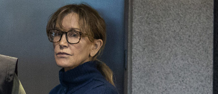 Actress Felicity Huffman is seen inside the Edward R. Roybal Federal Building and U.S. Courthouse in Los Angeles, on March 12, 2019. (Photo credit DAVID MCNEW/AFP/Getty Images)