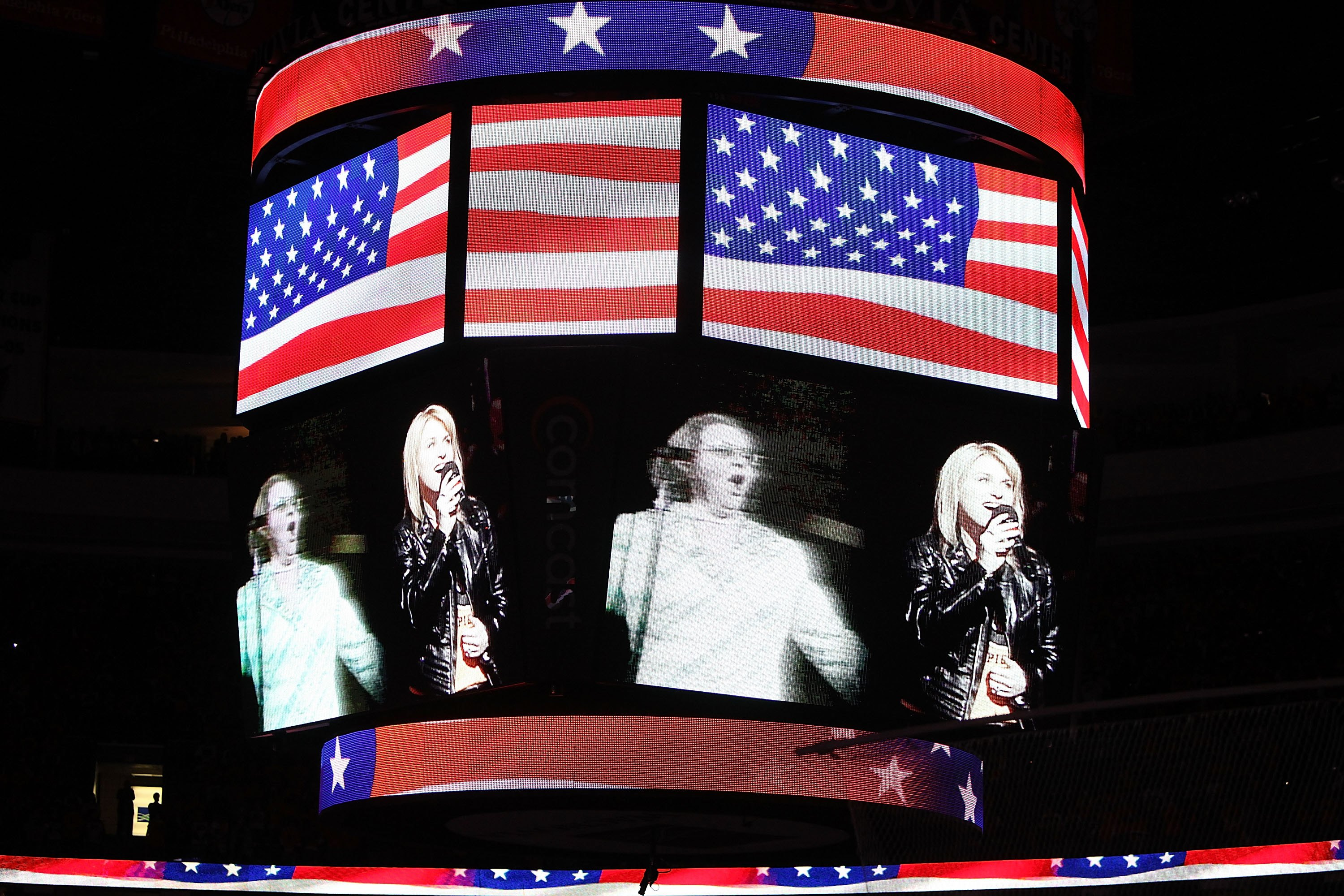Singers Lauren Hart and Kate Smith are seen on the screen before Game Six of the 2010 NHL Stanley Cup Final between the Chicago Blackhawks and the Philadelphia Flyers at the Wachovia Center on June 9, 2010 in Philadelphia, Pennsylvania. (Photo by Andre Ringuette/Getty Images)