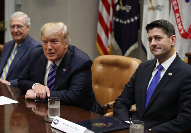 "WASHINGTON, DC - SEPTEMBER 05: U.S President Donald Trump (C) is flanked by Senate Majority Leader Mitch McConnell (R-KY), (L), and House Majority Leader Paul Ryan (R-WI), while speaking during a meeting with Congressional leaders in the Roosevelt Room on September 5, 2018 in Washington, DC. President Trump also spoke about Bob Woodward's new book ""Fear"". (Photo by Mark Wilson/Getty Images)"