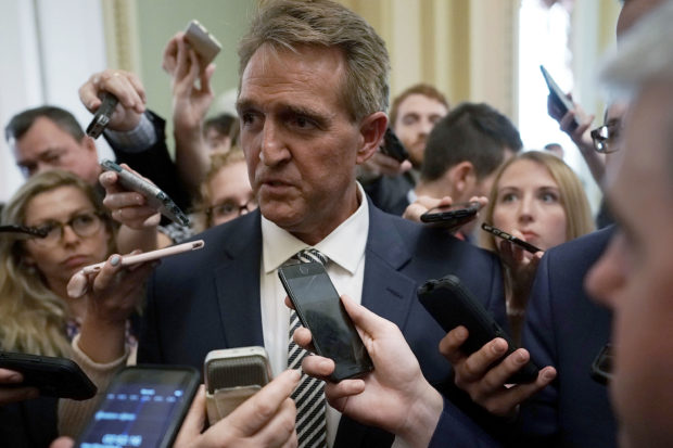 WASHINGTON, DC - SEPTEMBER 28: U.S. Sen. Jeff Flake (R-AZ) speaks to members of the media after a meeting in the office of Senate Majority Leader Sen. Mitch McConnell (R-KY) September 28, 2018 at the U.S. Capitol in Washington, DC. President Donald Trump has ordered a one-week-long supplemental FBI background investigation into sexual assault allegations made against Supreme Court nominee Judge Brett Kavanaugh after Sen. Flake requested to delay the full Senate vote for the investigation. (Photo by Alex Wong/Getty Images)