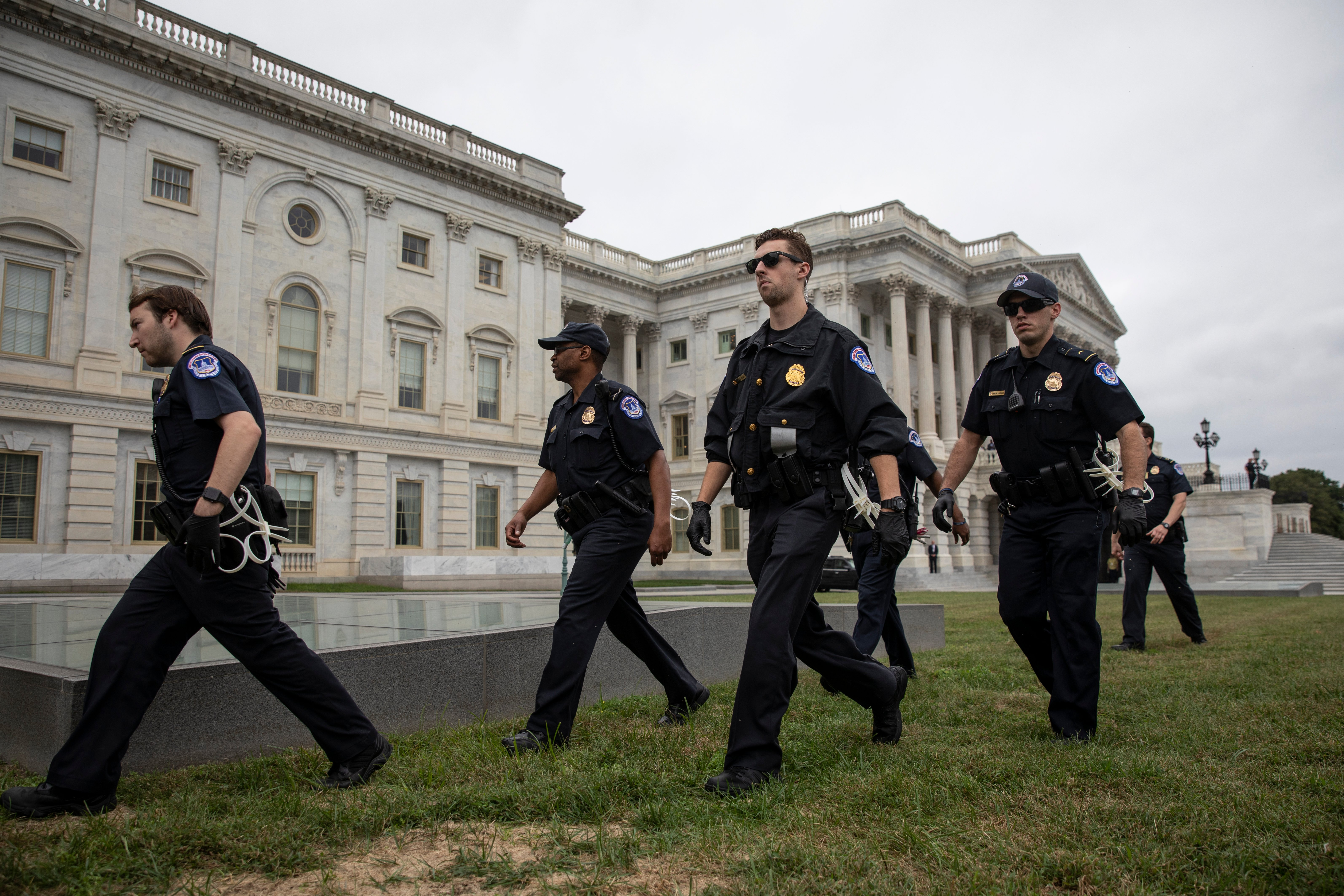 Capitol Police officers arrive as protestors occupy the steps on the East Front of the U.S. Capitol in protest of Supreme Court nominee Judge Brett Kavanaugh, October 6, 2018 in Washington, DC. (Photo by Drew Angerer/Getty Images)