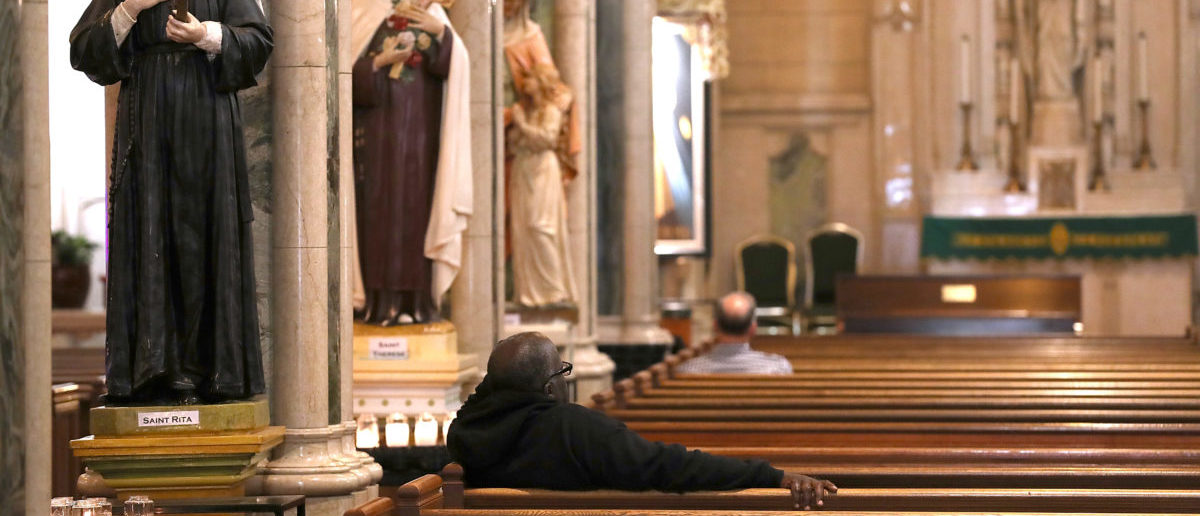 SAN FRANCISCO, CA - OCTOBER 24: People sit inside St. Patrick's Catholic Church on October 24, 2018 in San Francisco, California. (Justin Sullivan/Getty Images)