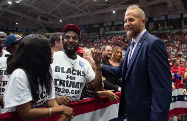 Brad Parscale (L), campaign manager for US President Donald Trump's 2020 reelection campaign, speaks with supporters during a campaign rally, in Estero, Florida, on October 31, 2018. (Photo by SAUL LOEB / AFP/Getty Images)