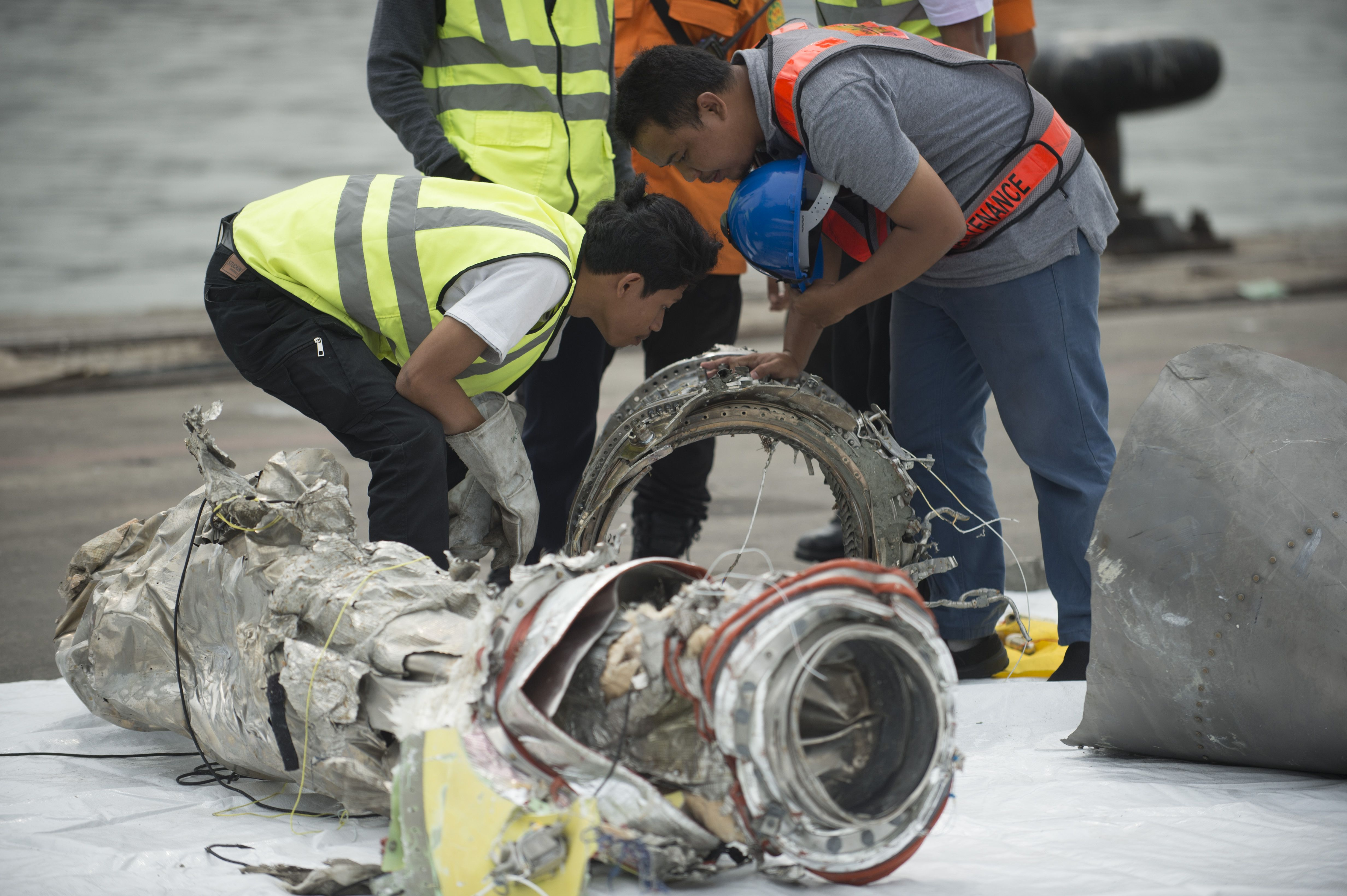Investigators examine engine parts from the ill-fated Lion Air flight JT 610 at a port in Jakarta on November 7, 2018, after they were recovered from the bottom of the Java sea. (BAY ISMOYO/AFP/Getty Images)