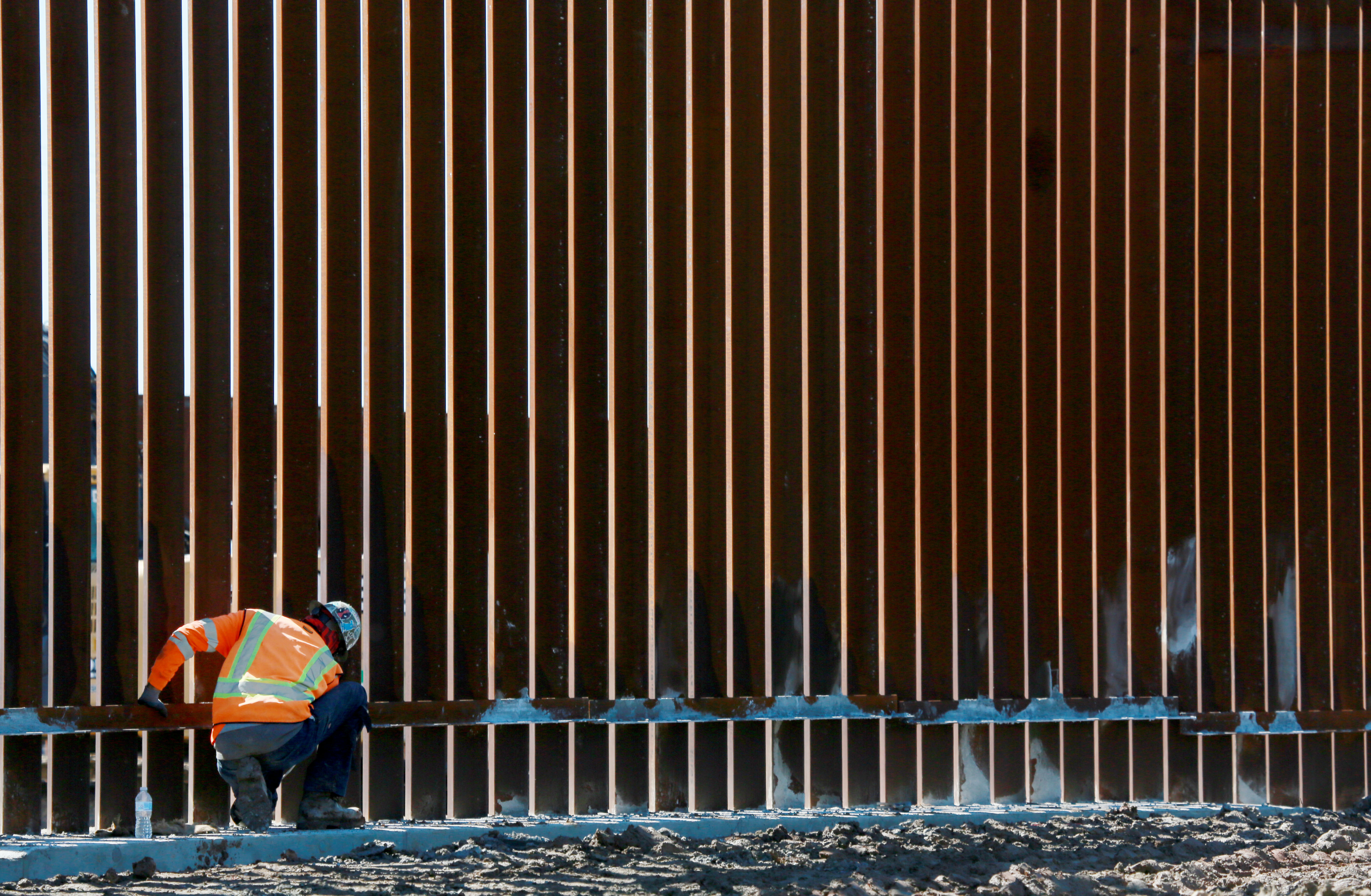 OTAY MESA, CA - FEBRUARY 22: A construction worker builds a secondary border wall on February 22, 2019 in Otay Mesa, California. The Department of Homeland Security is building 12.5 miles of secondary border wall as part of Presient Donald Trump's Border Security and Immigration Enforcement Improvements Executive Order to build new fencing along the Southern Border. (Photo by Sandy Huffaker/Getty Images)