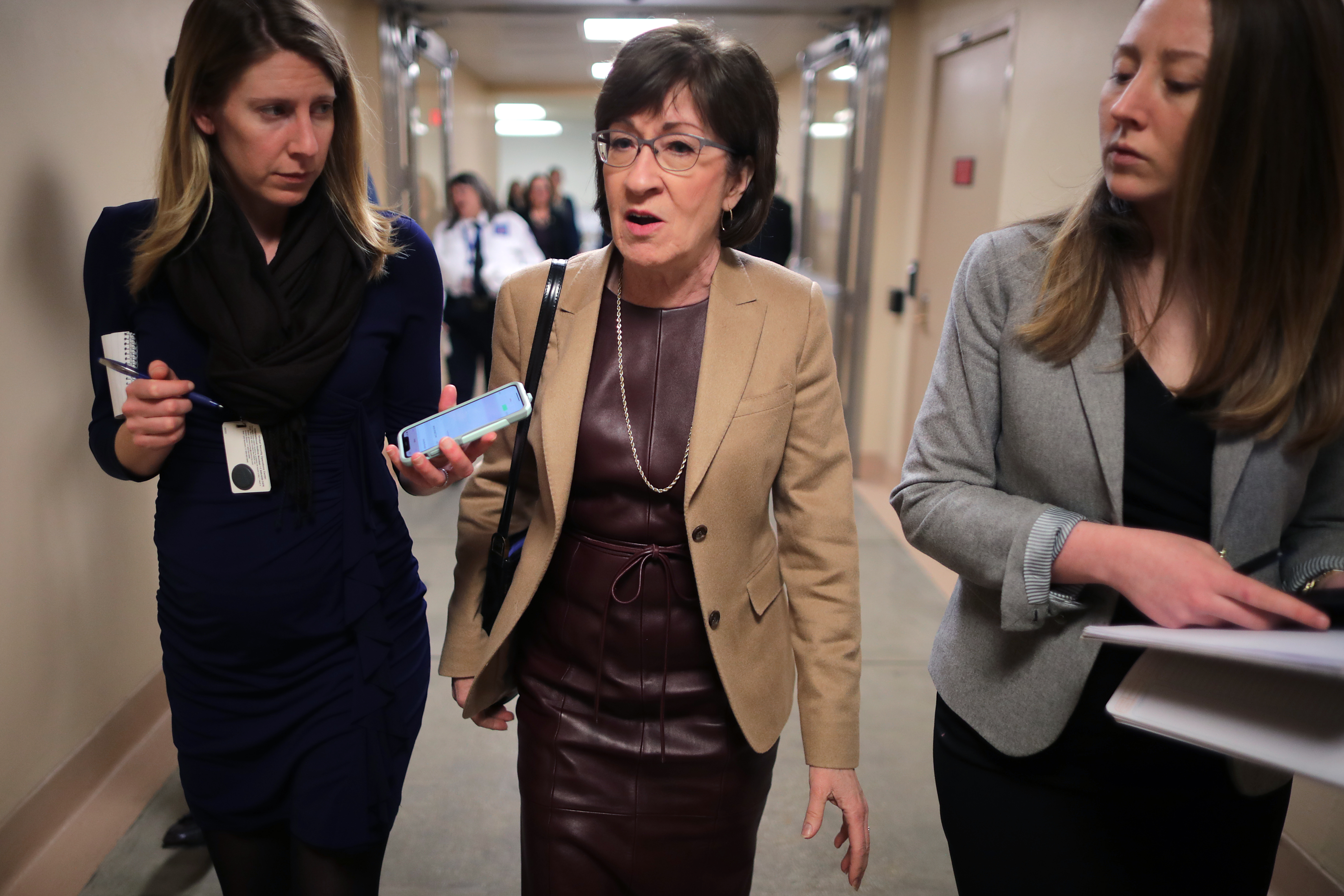 Sen. Susan Collins (R-ME) talks to reporters as she heads to the U.S. Capitol for the weekly Republican policy luncheon March 05, 2019 in Washington, DC. With the support of at least four Republicans, including Collins, the Senate seems poised to approve a resolution of disapproval on President Donald Trump's use of a national emergency declaration to secure the money he wants to build a border wall on the southern border. (Photo by Chip Somodevilla/Getty Images)