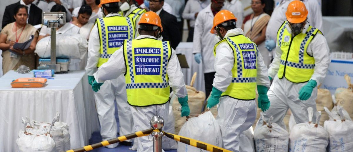Sri Lankan police personnel prepare bags of seized cocaine to be destroyed under judicial supervision at a suburb of Colombo on April 1, 2019. LAKRUWAN WANNIARACHCHI/AFP/Getty Images)
