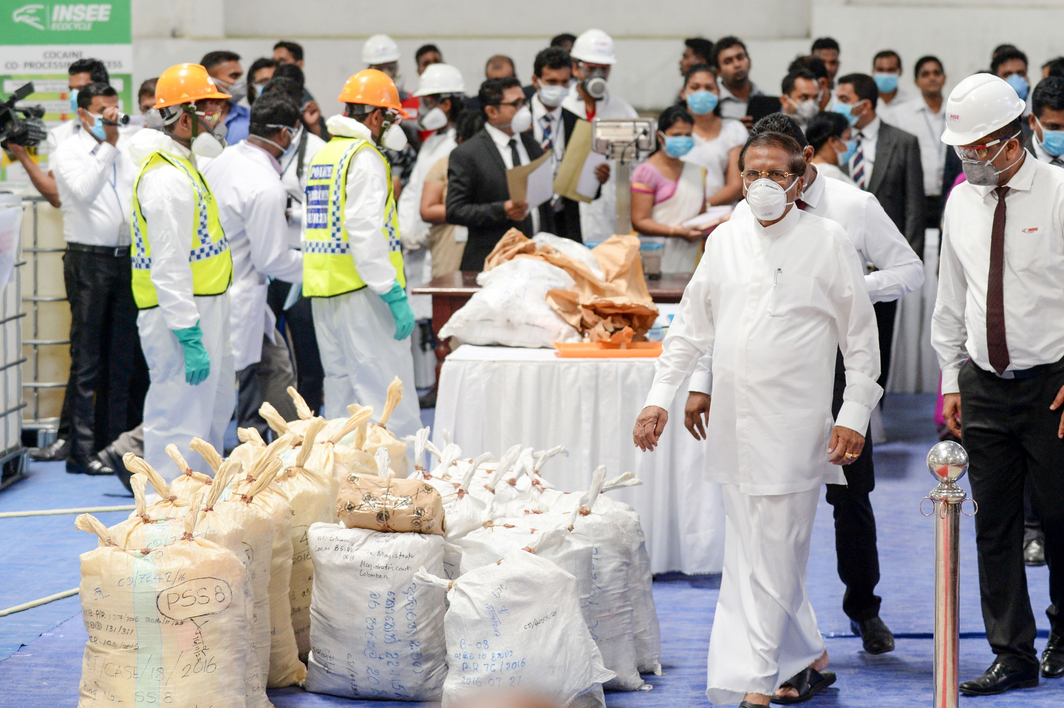 Sri Lankan president Maithripala Sirisena (2R) walks past seized cocaine prepared to be destroyed under judicial supervision at a suburb of Colombo on April 1, 2019. (LAKRUWAN WANNIARACHCHI/AFP/Getty Images)