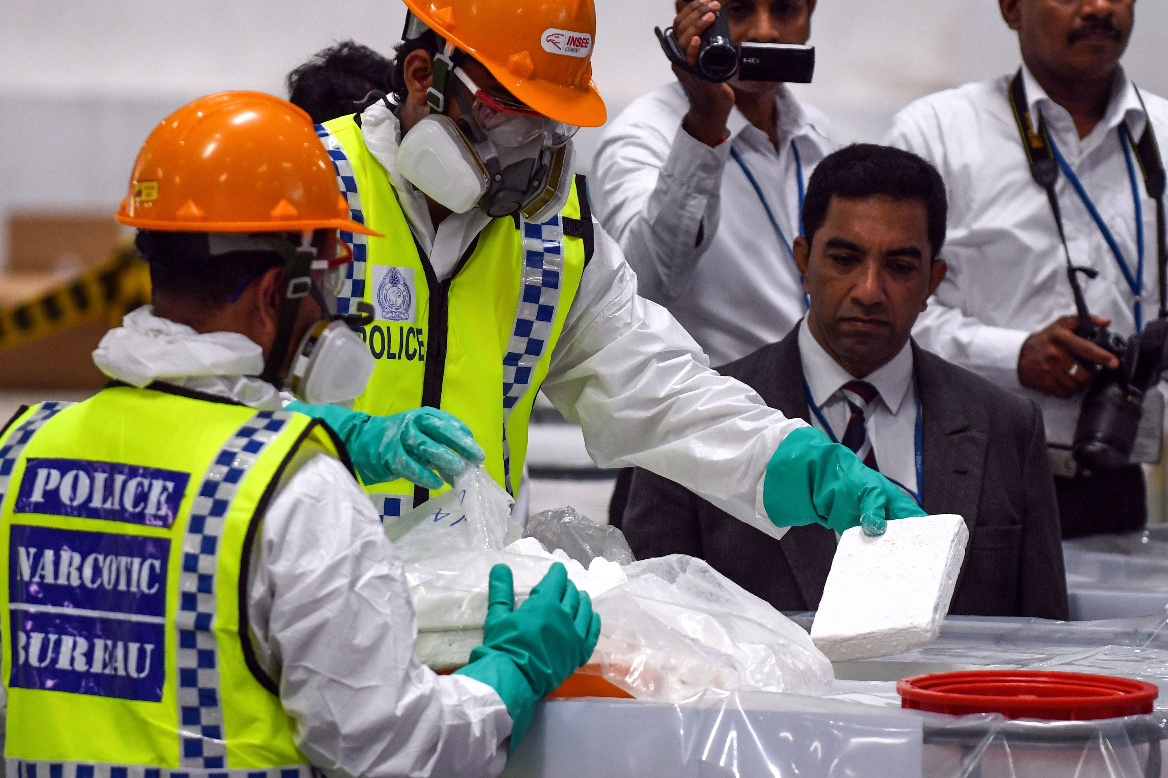 Sri Lankan police personnel prepare seized cocaine to be destroyed under judicial supervision at a suburb of Colombo on April 1, 2019. (LAKRUWAN WANNIARACHCHI/AFP/Getty Images)