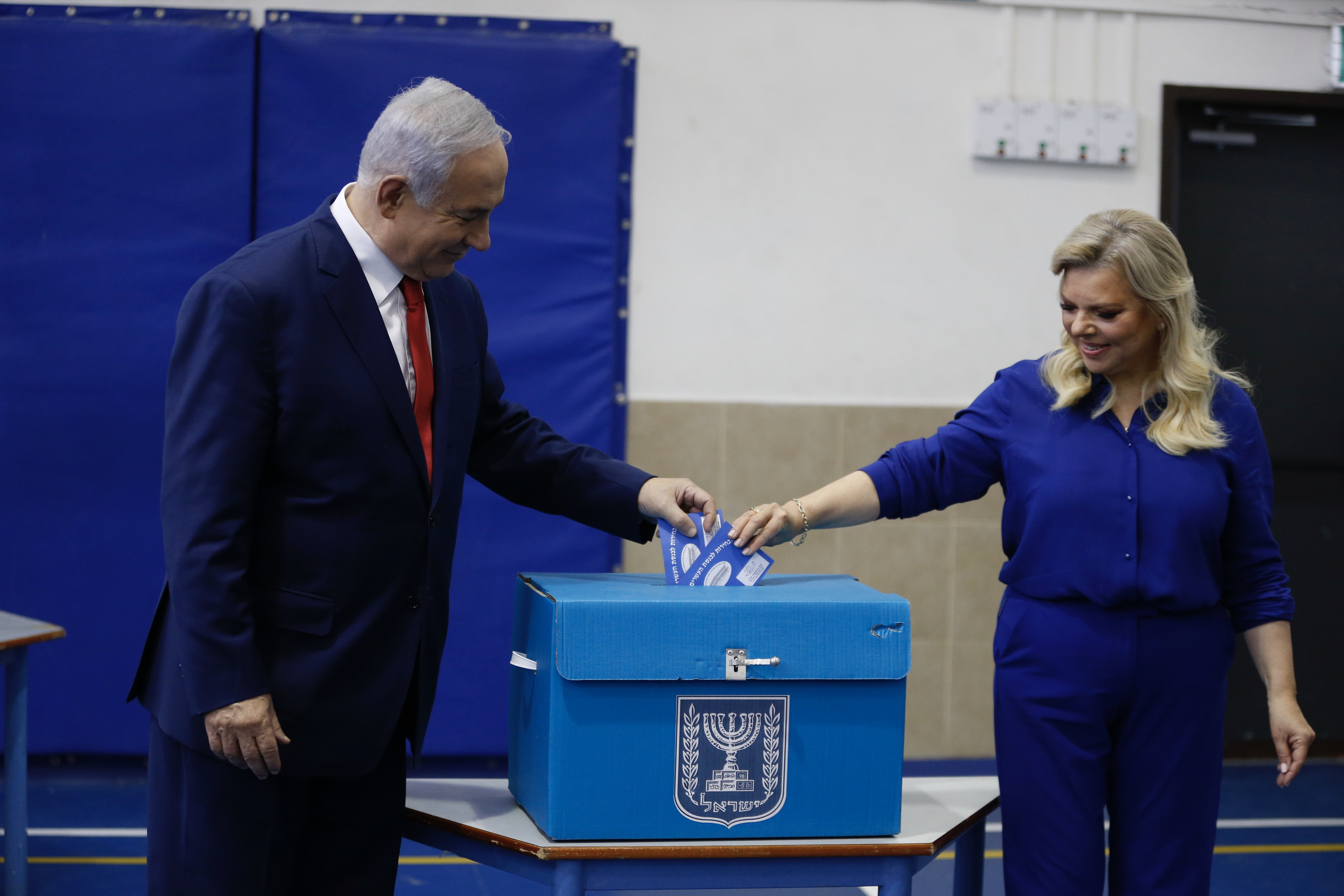 Israeli Prime Minister Benjamin Netanyahu and his wife Sara cast their votes during Israel's parliamentary elections in Jerusalem, on April 9, 2019. (ARIEL SCHALIT/AFP/Getty Images)