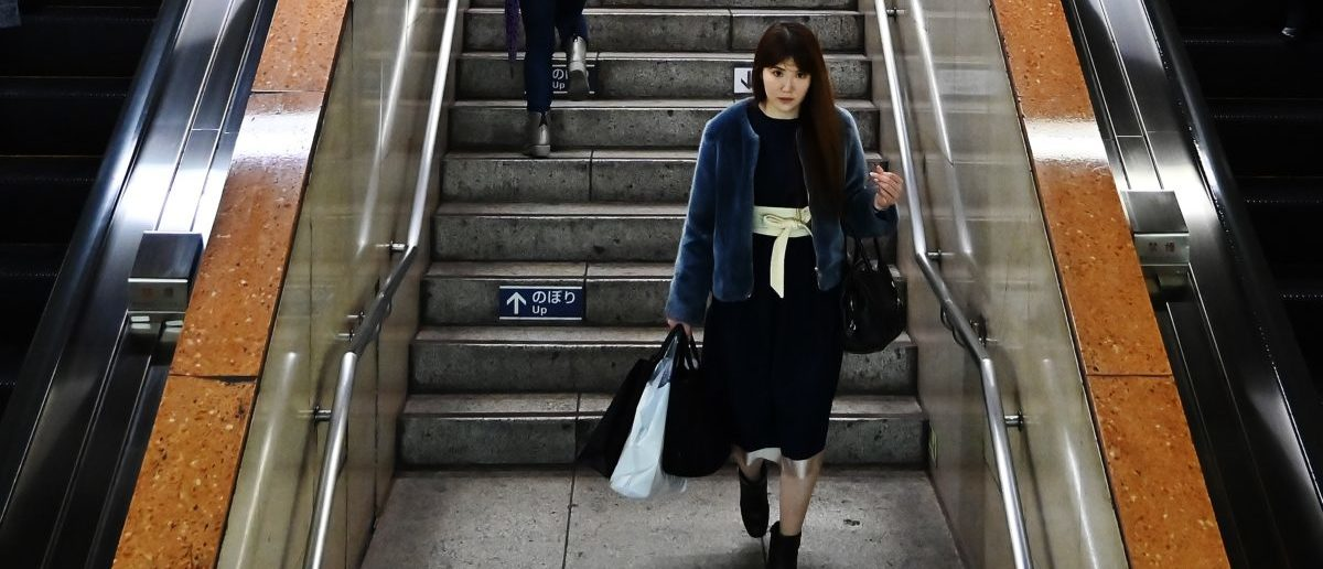 A woman walks in the stairs of the Ginza train station in Tokyo's Ginza district on on April 10, 2019. (CHARLY TRIBALLEAU/AFP/Getty Images)