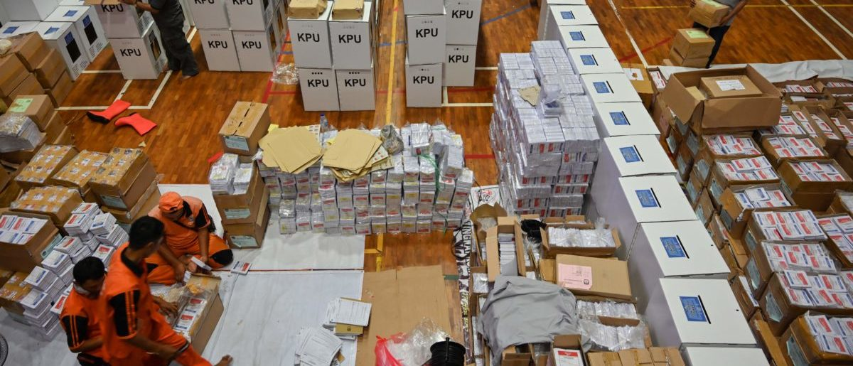 Officials prepare ballot boxes and other voting materials in Jakarta on April 11, 2019, ahead of presidential and legislative elections. (BAY ISMOYO/AFP/Getty Images)