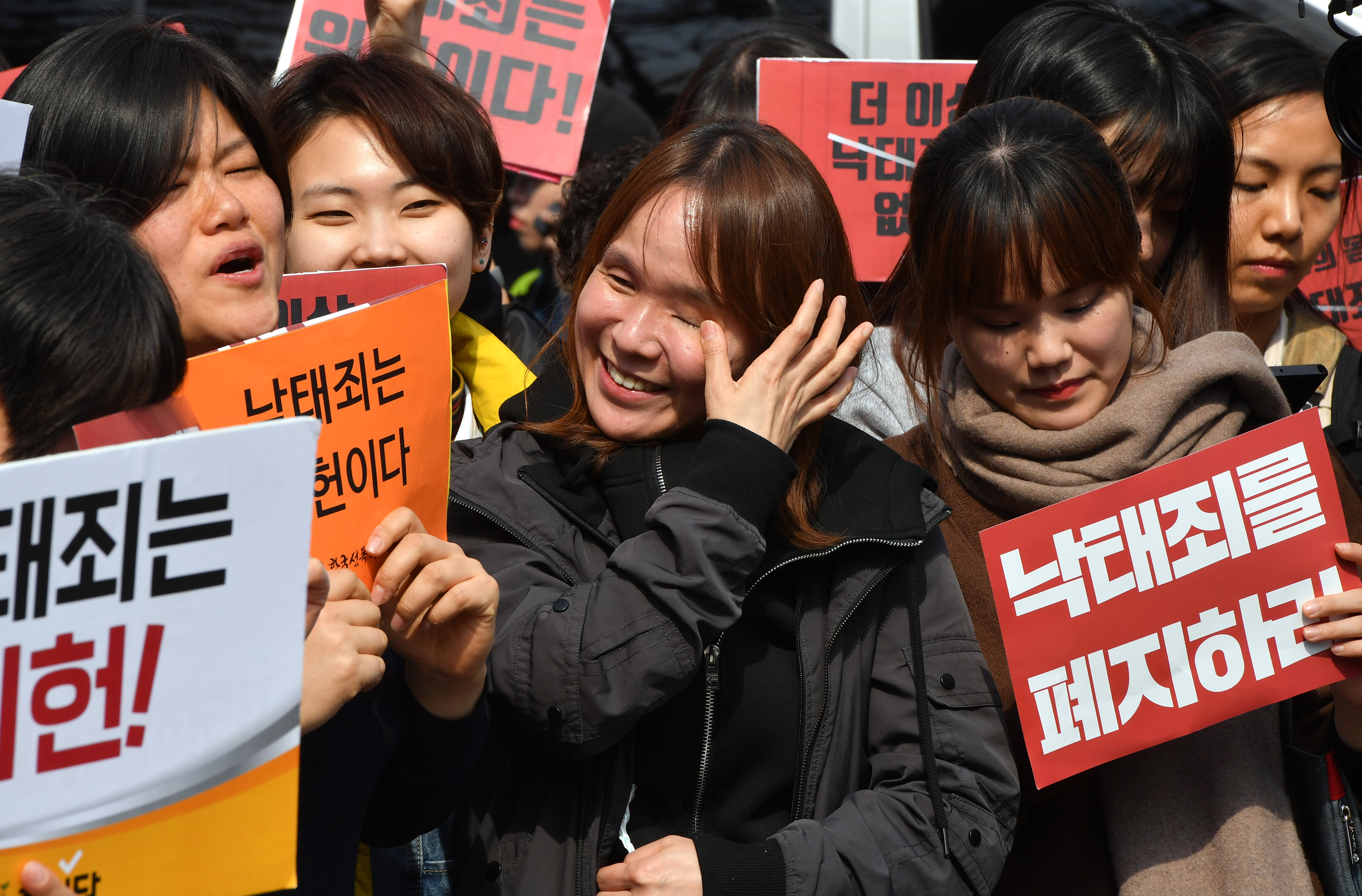 South Korean women's rights activists react after the constitutional court's ruling on decriminalisation of abortion during a rally against the abortion ban outside the court in Seoul on April 11, 2019. (JUNG YEON-JE/AFP/Getty Images)