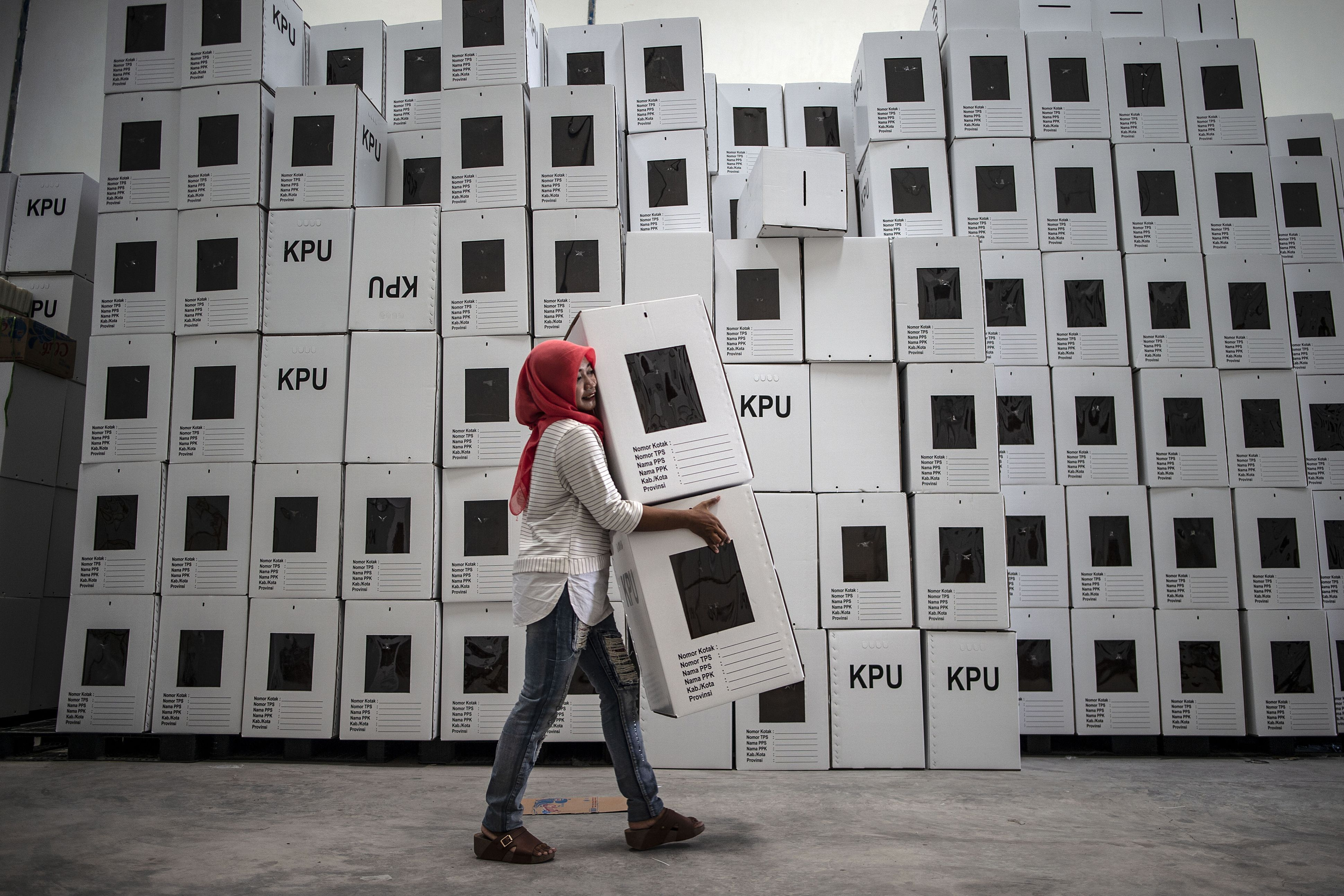 This picture taken on March 18, 2019 shows an Indonesian election commission worker arranging ballot boxes in Surabaya, in preparation for the upcoming April 17 presidential and parliamentary elections. (JUNI KRISWANTO/AFP/Getty Images)