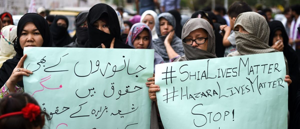 Pakistani Shiite Muslims hold placards as they protest against the suicide blast targeting the Shia Hazara ethnic minority, in Karachi on April 14, 2019. (RIZWAN TABASSUM/AFP/Getty Images)