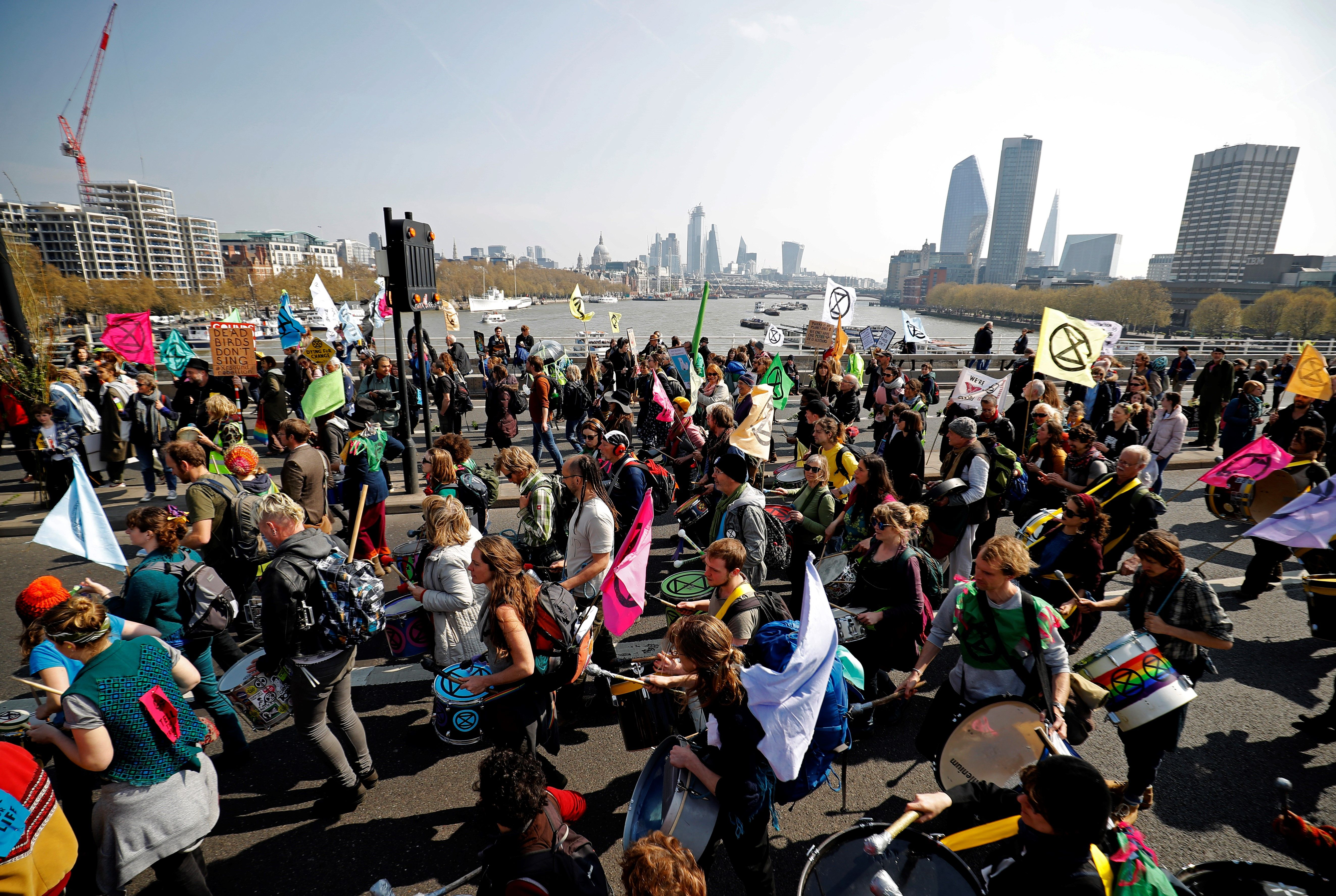 Environmental protesters from the Extinction Rebellion arrive to stage a demonstration, on Waterloo Bridge in London on April 15, 2019. (TOLGA AKMEN/AFP/Getty Images)