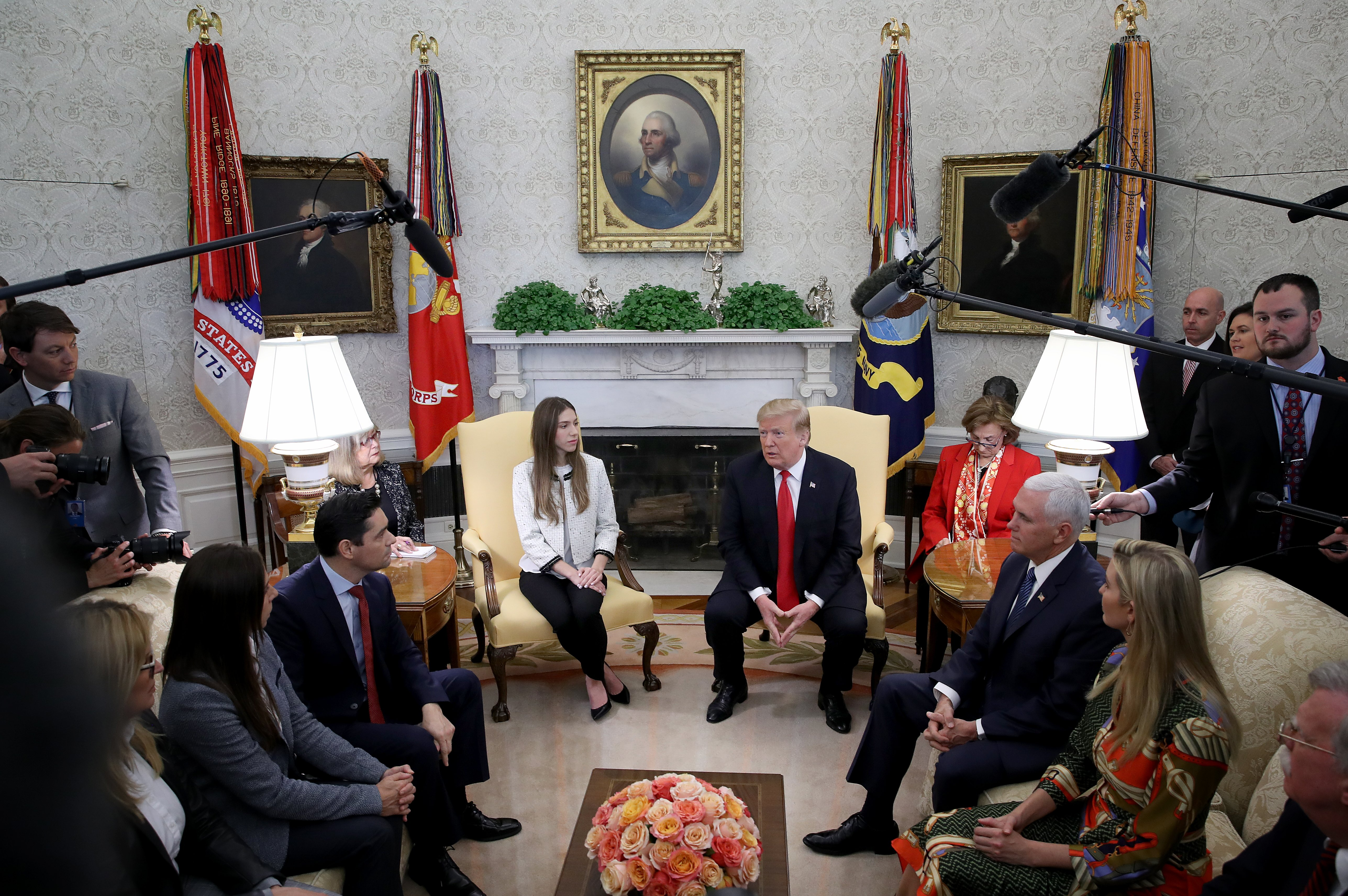 U.S. President Donald Trump and Vice President Mike Pence meet with Fabiana Rosales (L), the wife of Venezuelan opposition leader Juan Guaido, in the Oval Office of the White House March 27, 2019 in Washington, DC. (Photo by Win McNamee/Getty Images)