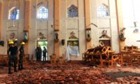 Security personnel inspect the interior of St. Sebastian's Church in Negombo on April 22, 2019, a day after the church was hit in series of bomb blasts targeting churches and luxury hotels in Sri Lanka. (ISHARA S. KODIKARA/AFP/Getty Images)