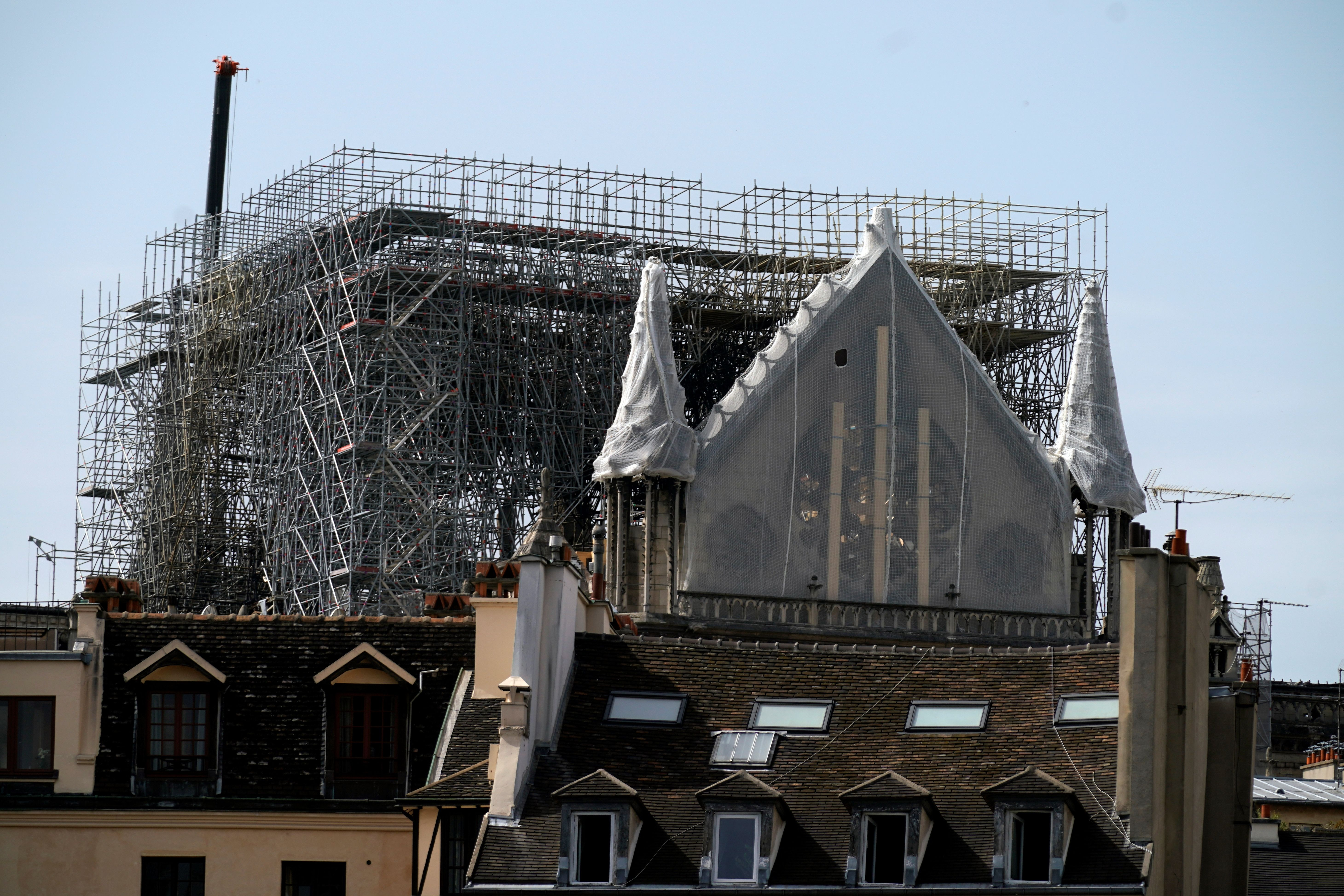 The Rosette of Notre-Dame de Paris Cathedral in Paris on April 22, 2019, is covered with protective material, seven days after a fire devastated the cathedral. LIONEL BONAVENTURE/AFP/Getty Images