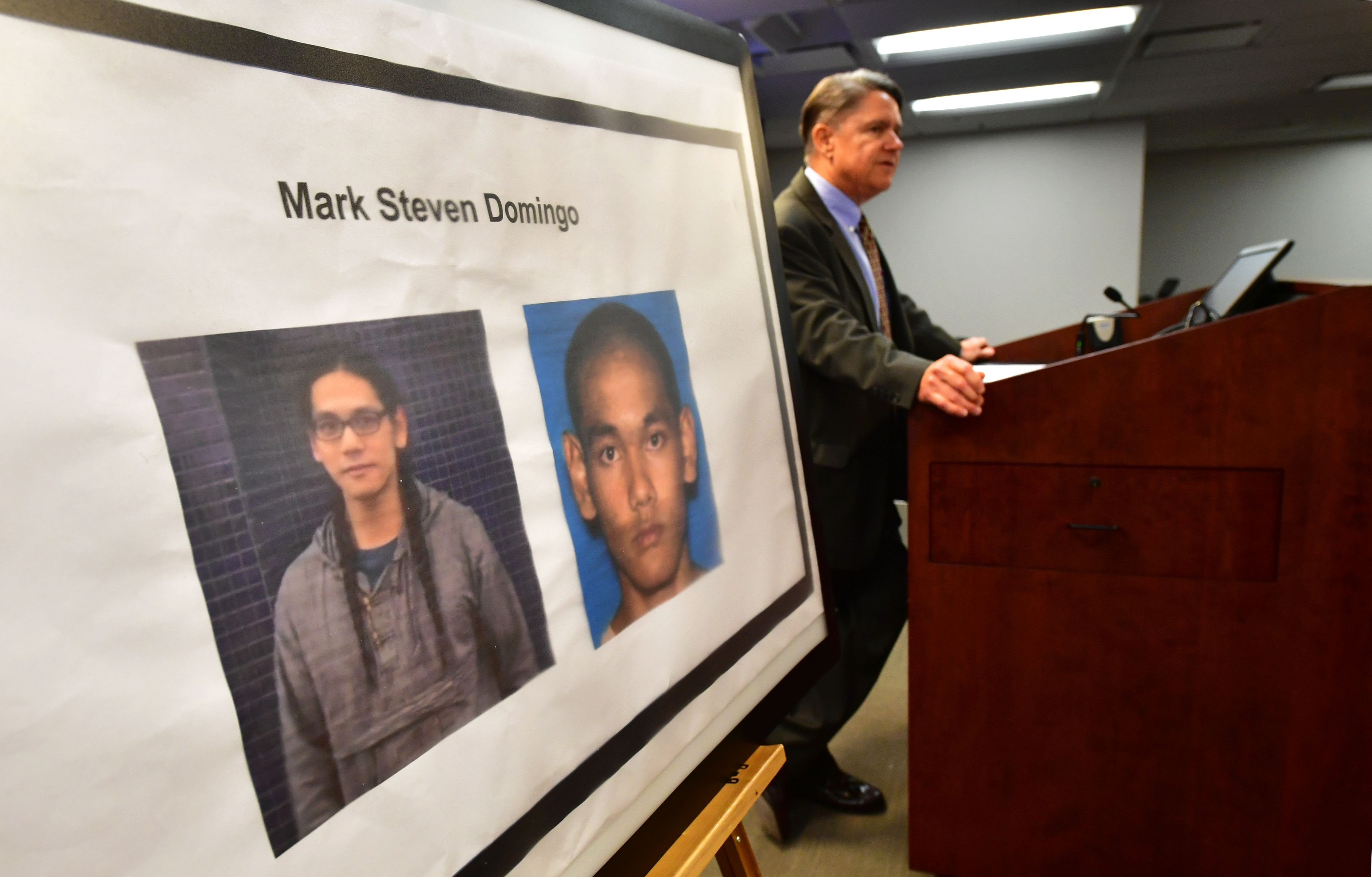 Thom Mrozek of the US Attorney's Office briefs the media beside photographs of a suspect arrested in connection with an alleged terror plot targetting Southern California sites on April 29, 2019 in Los Angeles, California where Federal and local law enforcement officials announced the results of a major counterterrorism investigation. (FREDERIC J. BROWN/AFP/Getty Images)