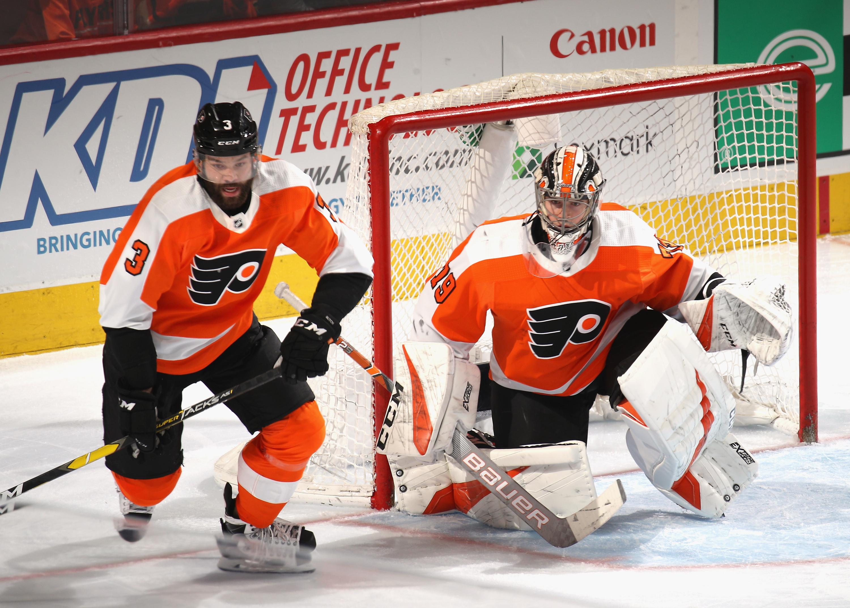 Radko Gudas #3 and Carter Hart #79 of the Philadelphia Flyers skates against the Carolina Hurricanes at the Wells Fargo Center on April 06, 2019 in Philadelphia, Pennsylvania. (Photo by Bruce Bennett/Getty Images)