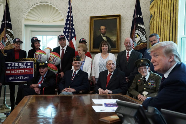 WASHINGTON, DC - APRIL 11: U.S. President Donald Trump meets with World War II veterans (L-R) Sidney Walton, Allen Jones, Paul Kriner and Floyd Wigfield in the Oval Office of the White House April 11, 2019 in Washington, DC. President Trump hosted the veterans and their families to honor their service during WWII. (Photo by Alex Wong/Getty Images)