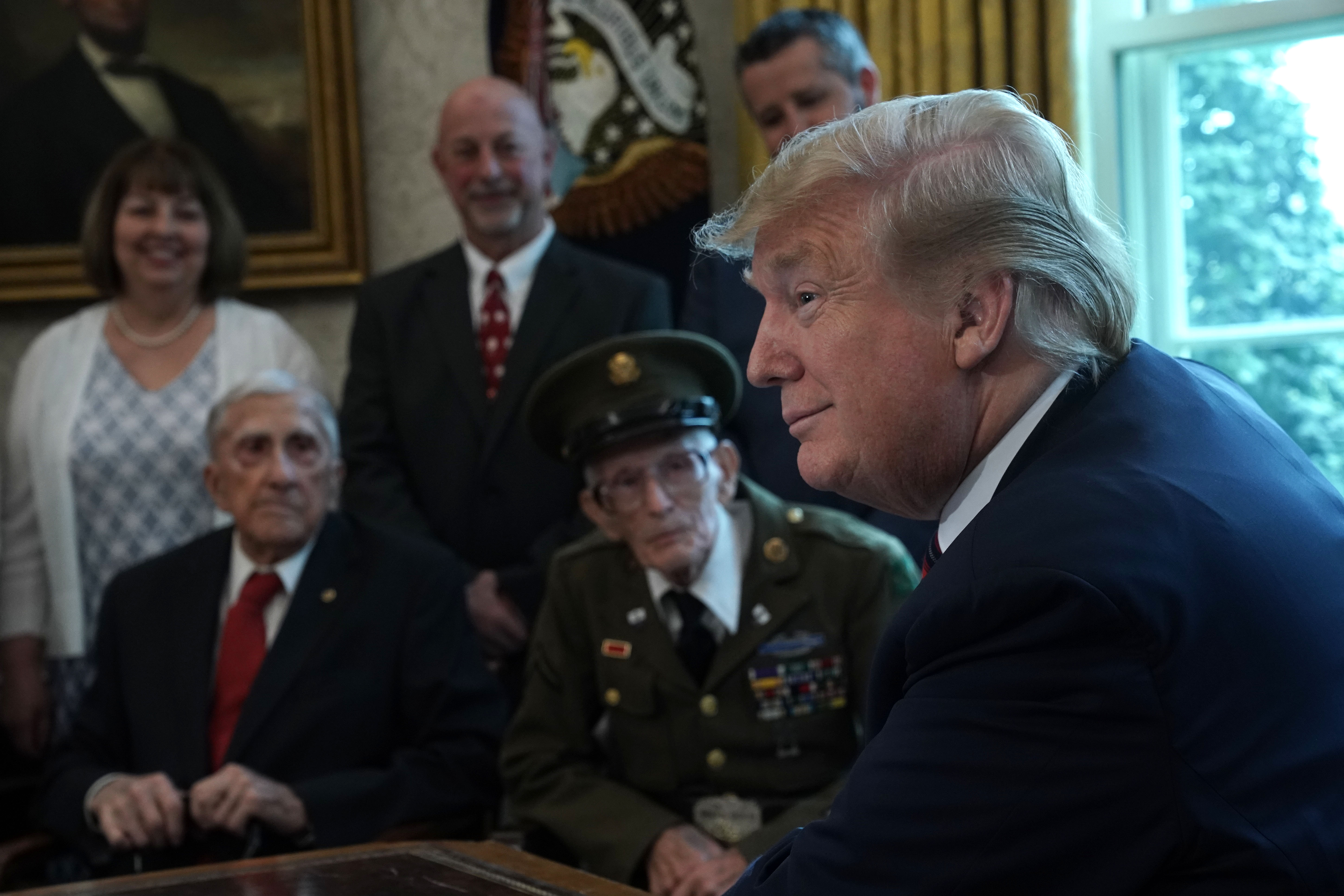 U.S. President Donald Trump meets with World War II veterans including Paul Kriner and Floyd Wigfield in the Oval Office of the White House April 11, 2019 in Washington, DC. (Photo by Alex Wong/Getty Images)